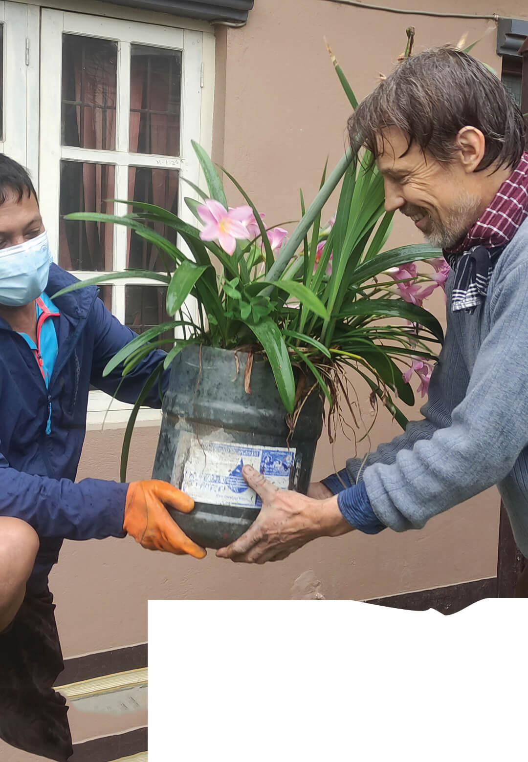 Prof. Anne Feenstra with a resident contributing Zephyr lilies and Amaryllis for the community park in Nepal | STIR Columns | Nepal | STIRworld
