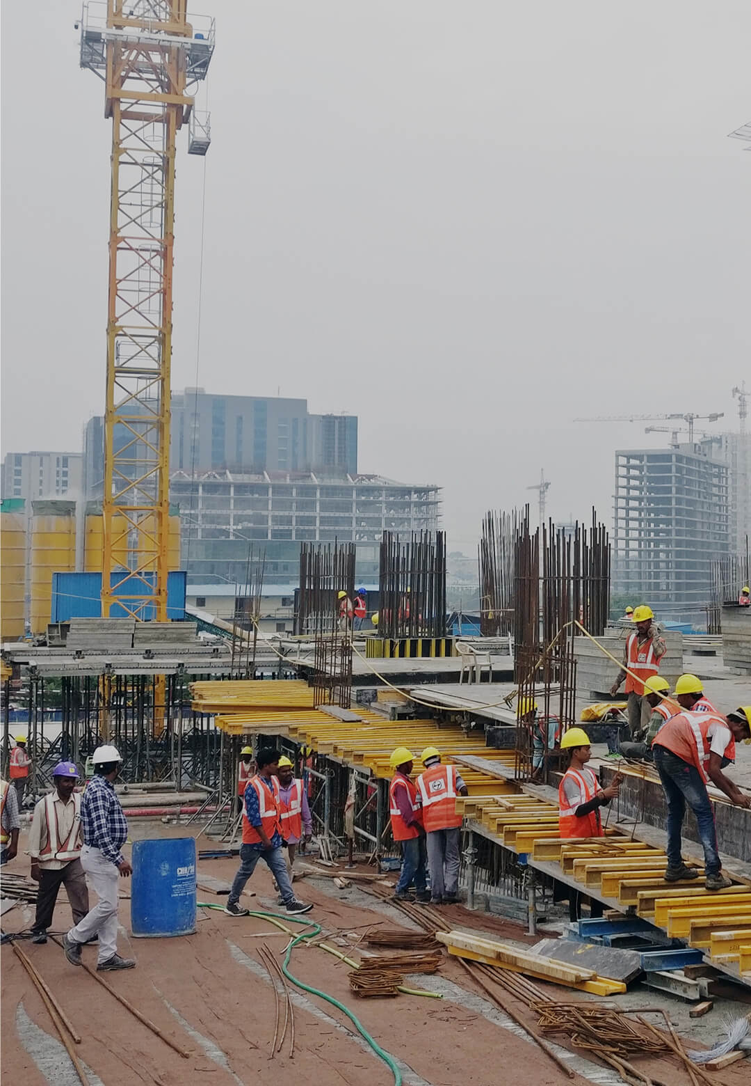 View of a multistory office building under construction with vertical reinforcement for columns | Training of migrants returning home | STIRworld