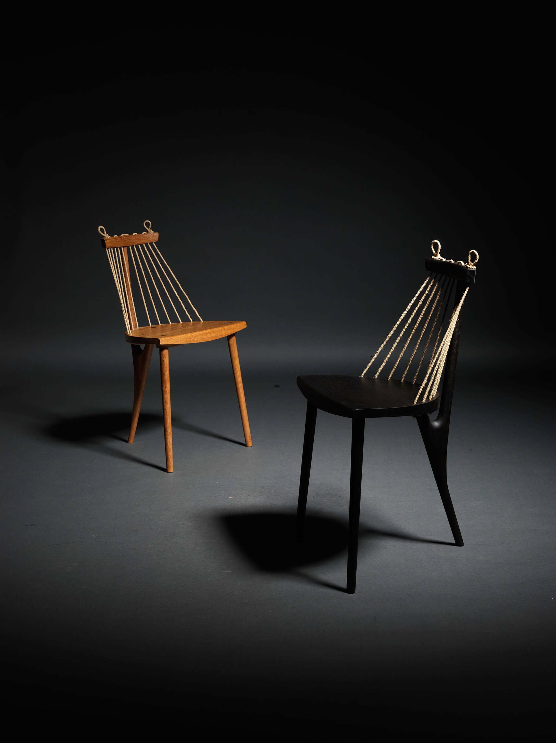 Three legged chair natural (L) and ebonized (R) | Made in Brazil: Curated by Campana Brothers | STIR X Script |STIRworld