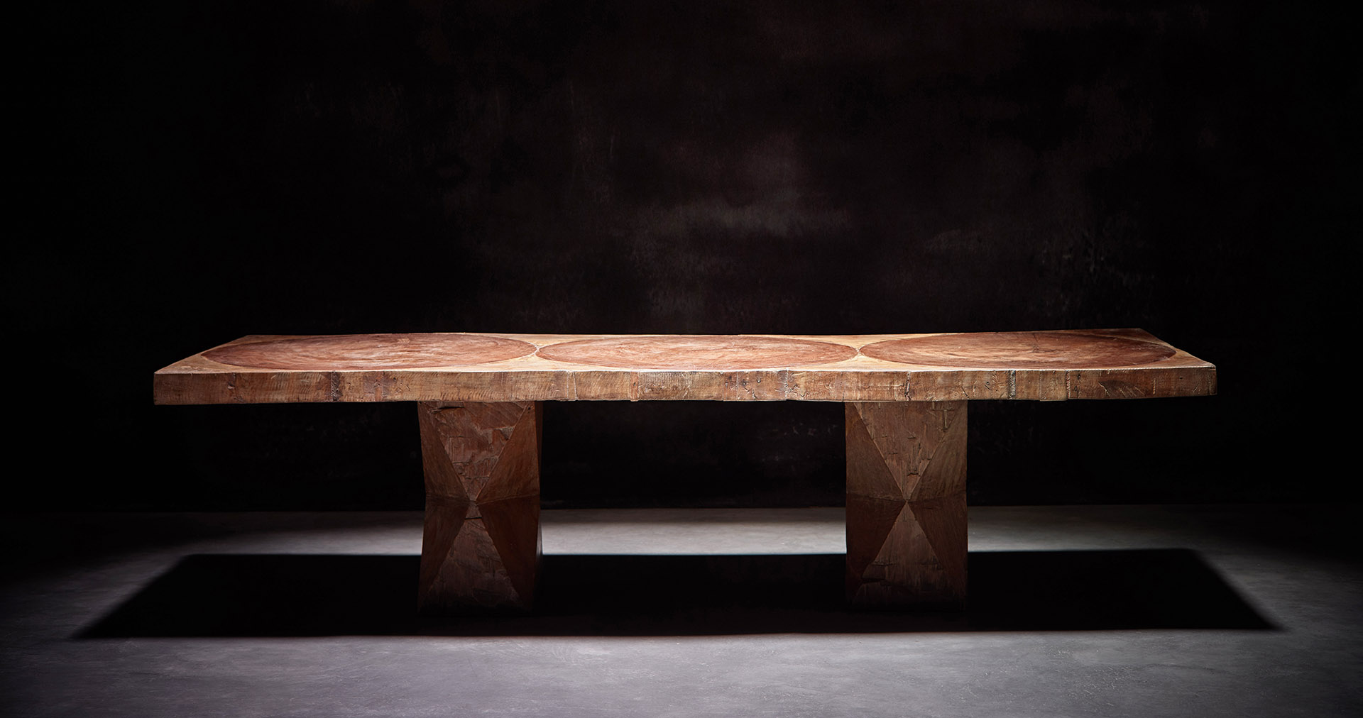 A rectangular sculpted table (1979) by Jose Zanine Caldas at Axel Vervoordt's booth| Masterpiece London Art Fair| Royal Hospital Chelsea| STIR
