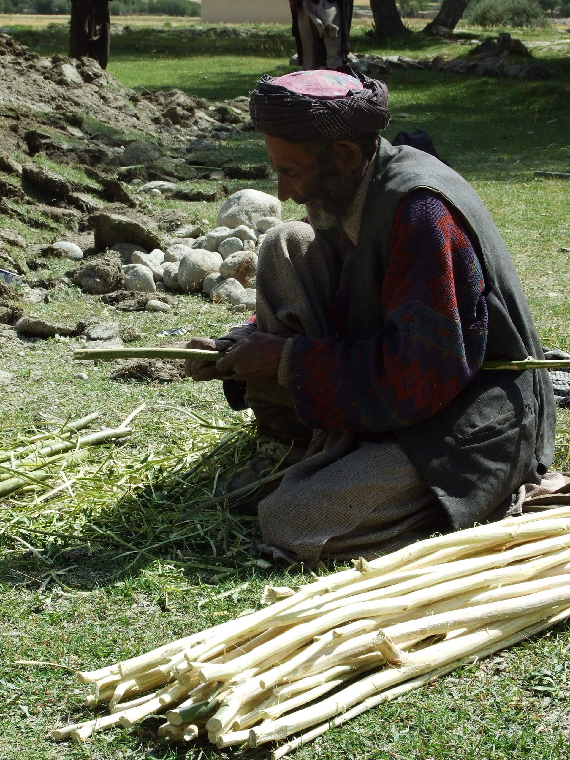 A local fellow preparing willow sticks for the ceiling of House with Dancing Windows | Cross Border Conversations | Pradip Krishen X Prof. Anne Feenstra | STIR X LOCO Design