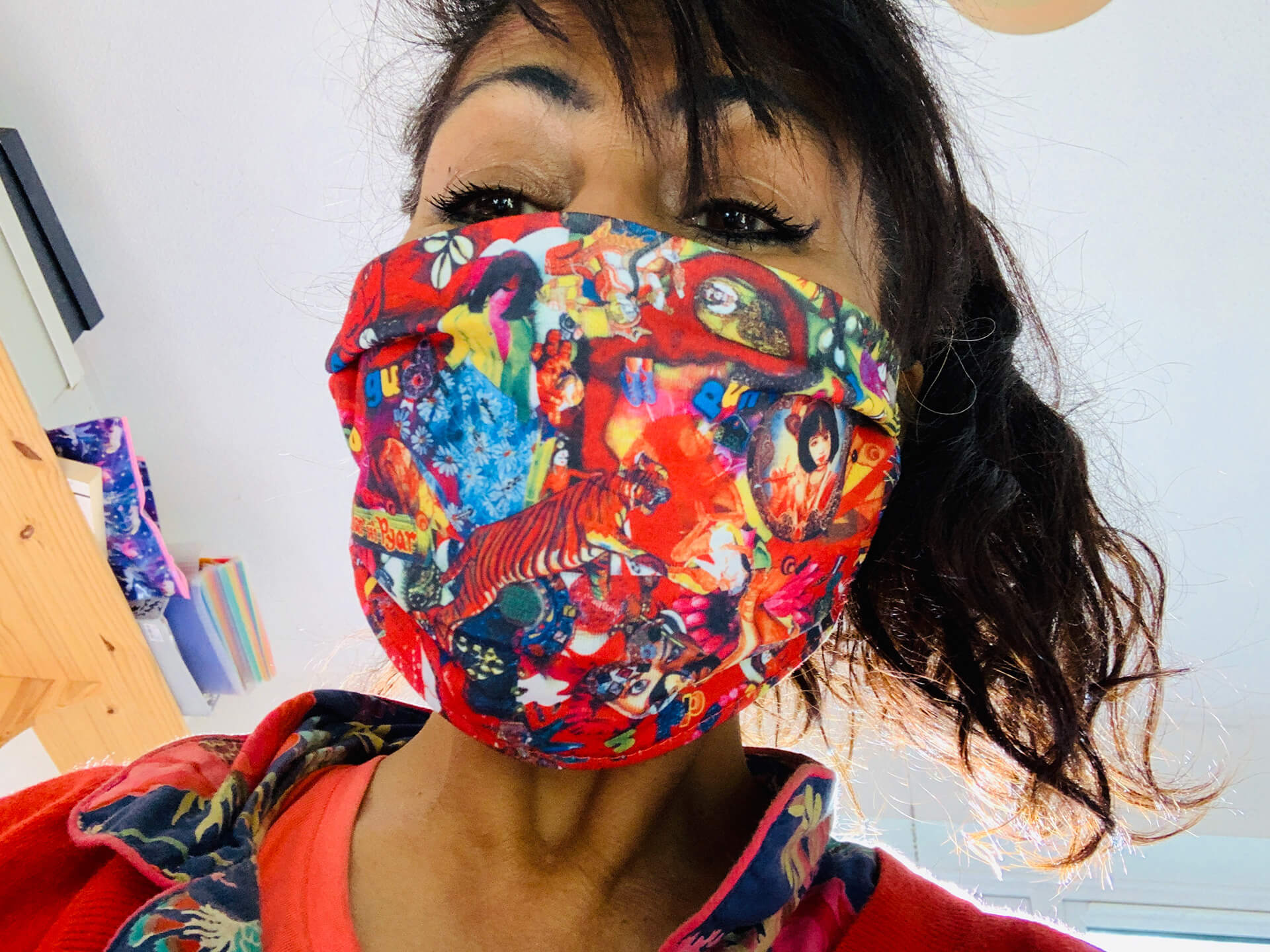 The artist sporting a 'Punjabi Rockers' face mask, which can be purchased at the Tate Britain's shop on the unveiling of the façade | Tate Britain Winter Commission | Chila Kumari Singh Burman | STIRworld