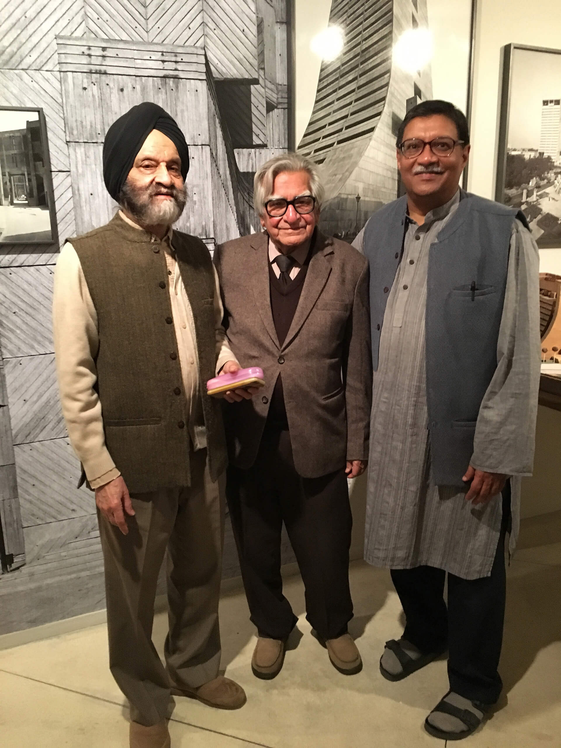 From left to right: Late architect Kuldip Singh, structural engineer Mahendra Raj, and photographer at the exhibition 'Delhi: Building the Modern' at KNMA Delhi in 2017 | Kuldip Singh tribute | STIRworld