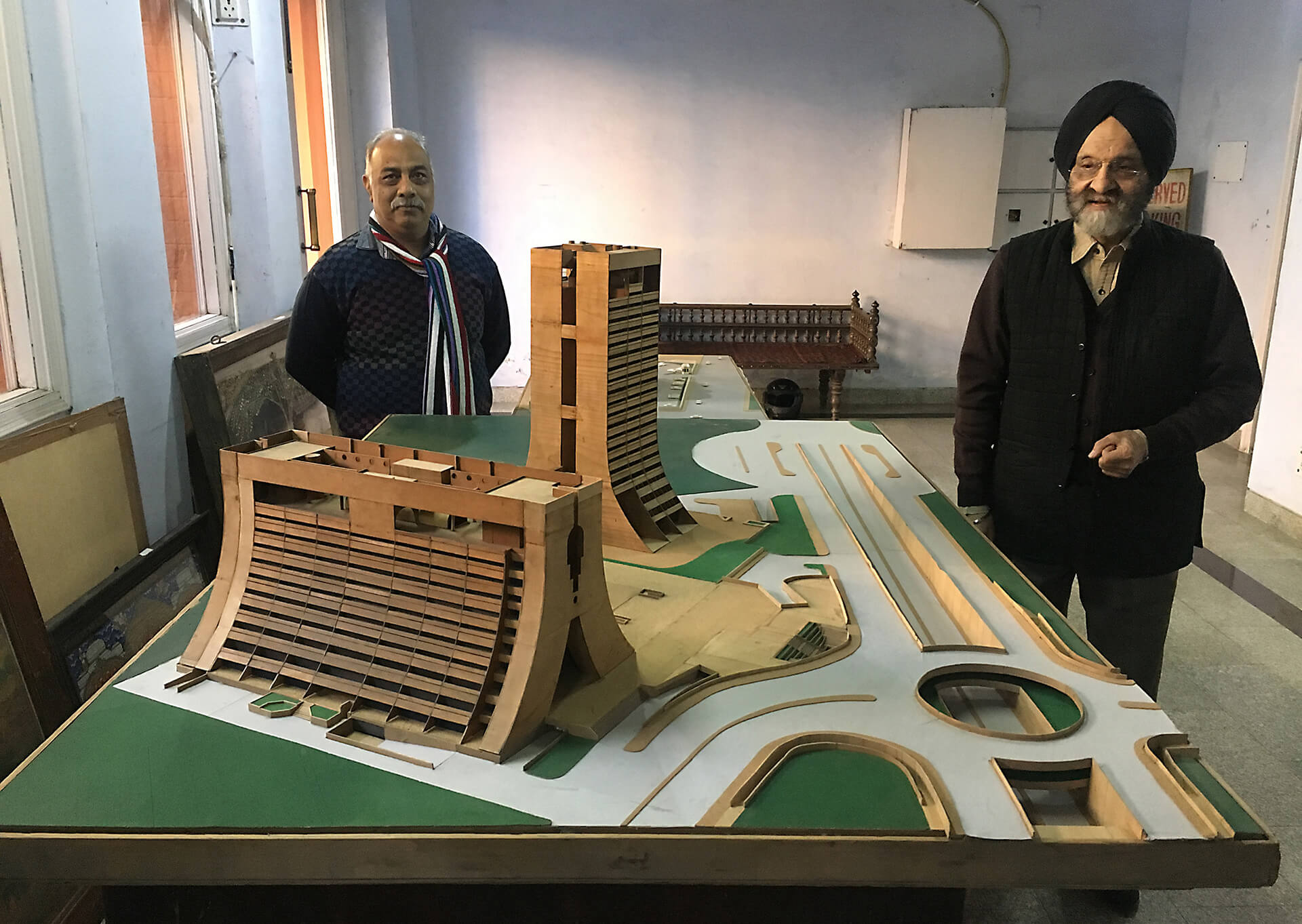 Kuldip Singh (right) with his model of the iconic NCDC building in Delhi | Kuldip Singh tribute| STIRworld