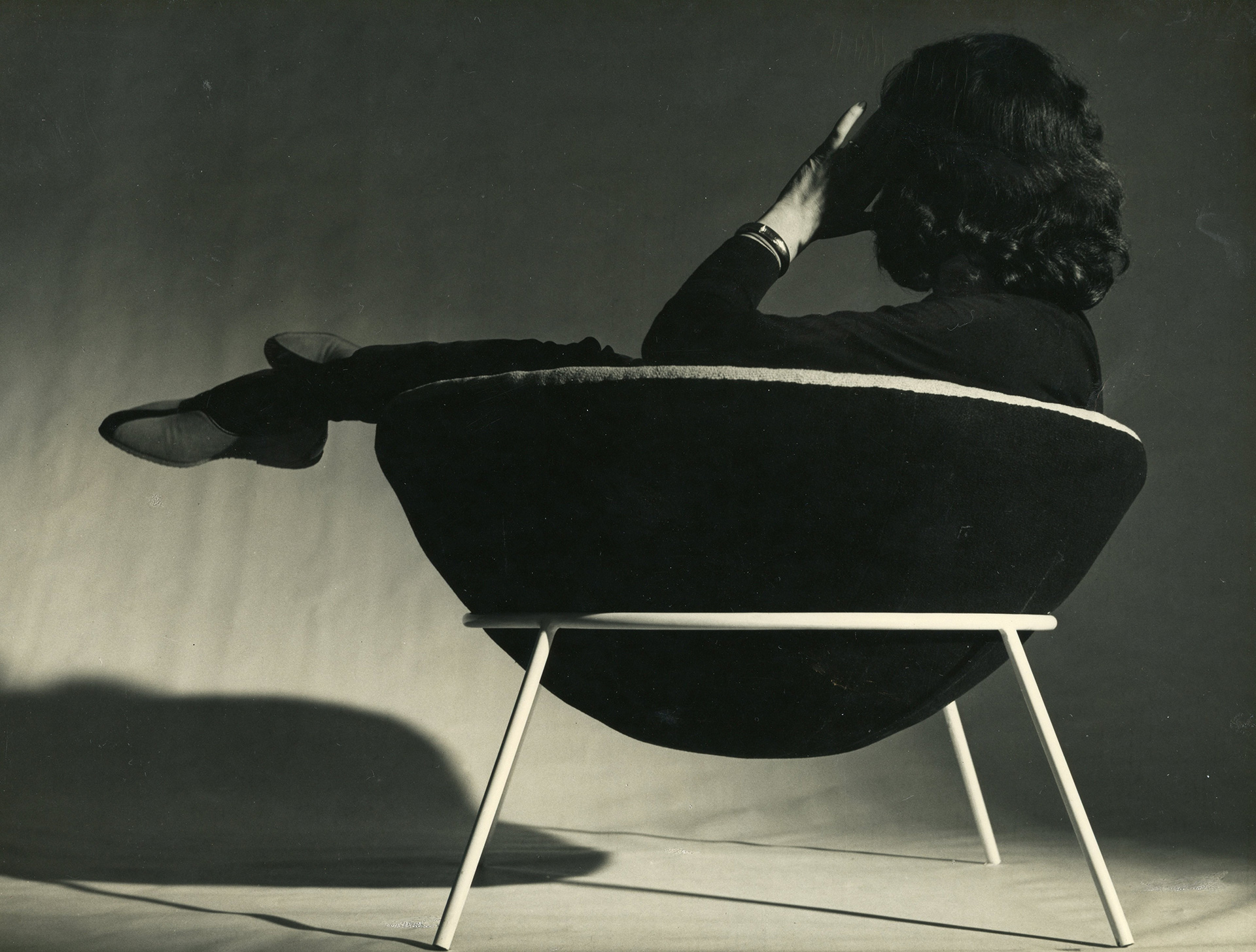 Lina Bo Bardi sitting on a Bardi's Bowl| The Special Golden Lion for Lifetime Achievement, in memoriam, Biennale Architettura 2021 | Lina Bo Bardi | STIRworld