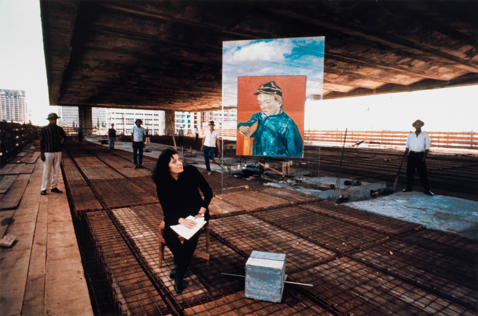 Lina Bo Bardi and a glass easel displaying a Van Gogh painting at the MASP construction site| The Special Golden Lion for Lifetime Achievement, in memoriam, Biennale Architettura 2021 | Lina Bo Bardi | STIRworld