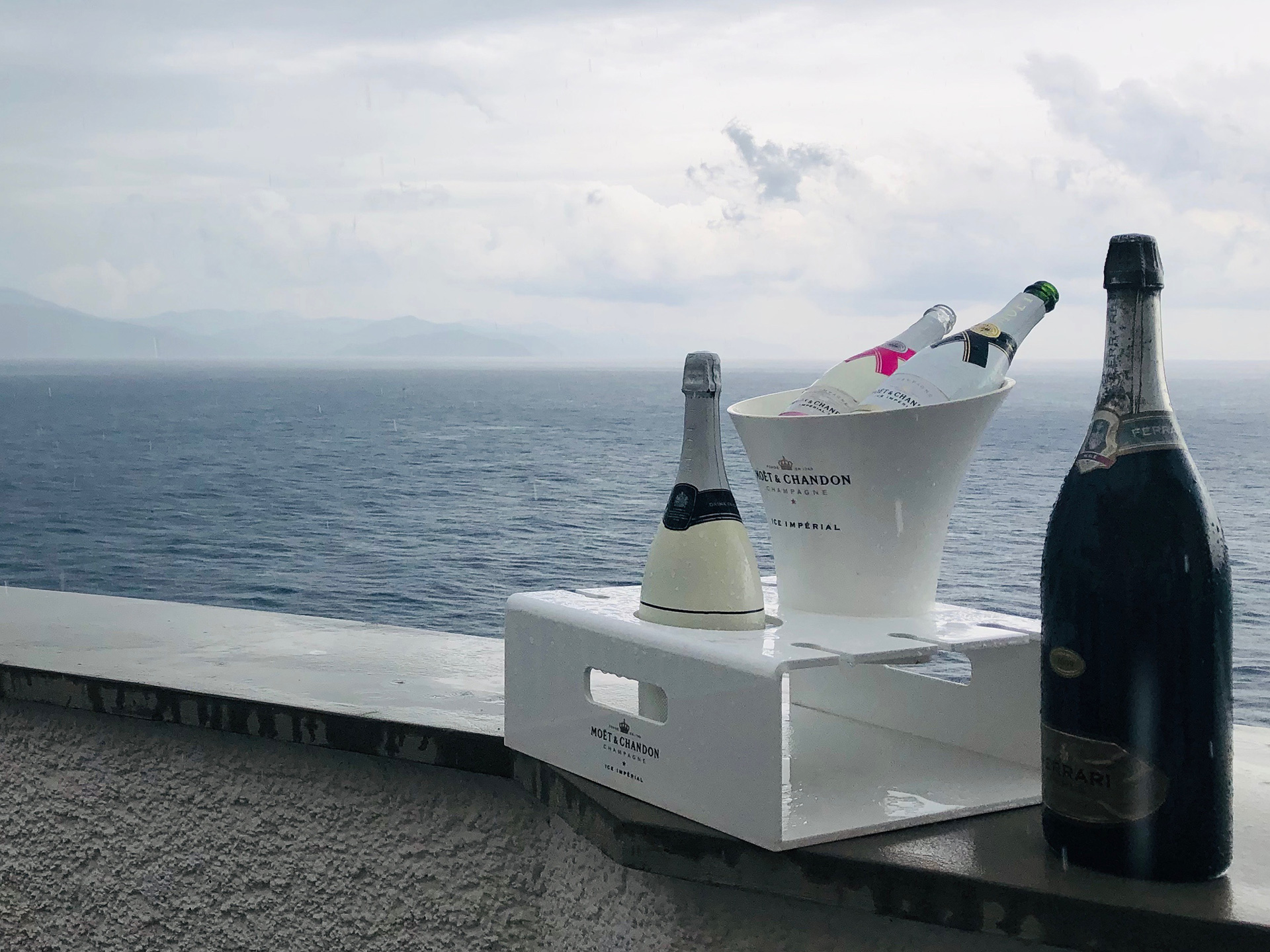 A bottle of Moet & Chandon perched on a precipice, in a café and bar at Corniglia | Cinque Terre| Italy| STIR
