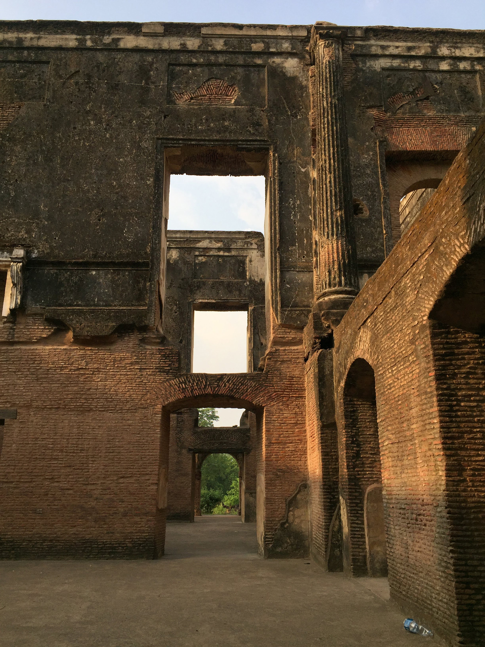 The raw brickwork looks from one time and the stucco remnants of another one, each rich with algae| The Residency| Lucknow| Soumitro Ghosh| STIR