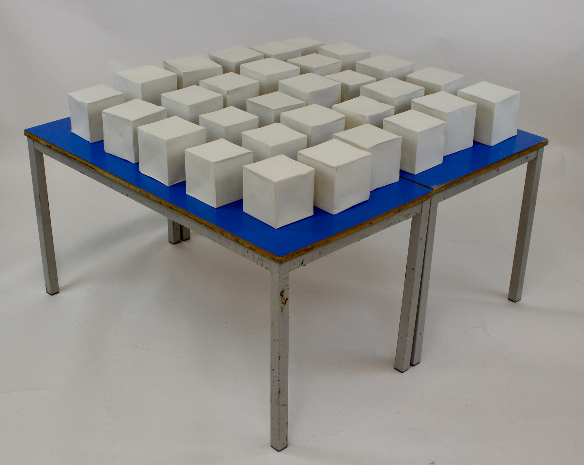 Held Breath, slip-cast porcelain, school tables, sound (H:70 cm W:120 cm D:120 cm), 2019| Gaby Solly| STIR