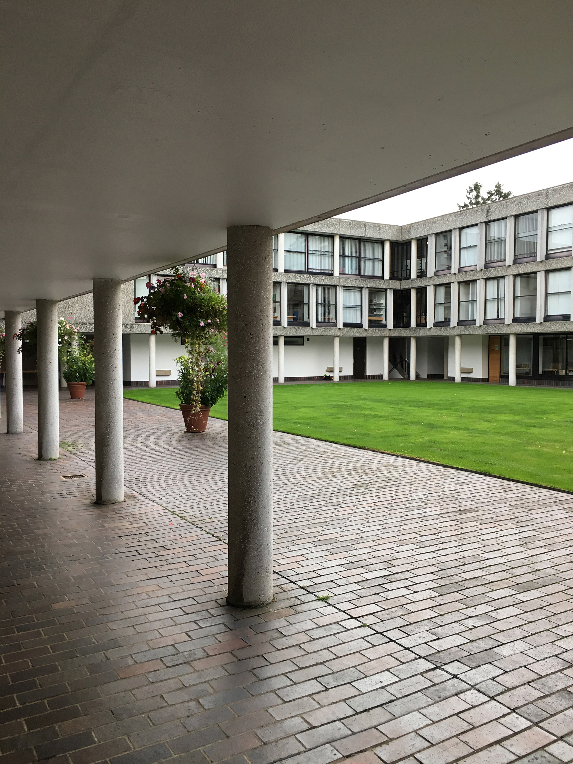 "The brick flooring in the colonnade facing the inner ""quads"" has acquired the prized patina of rigorous use 