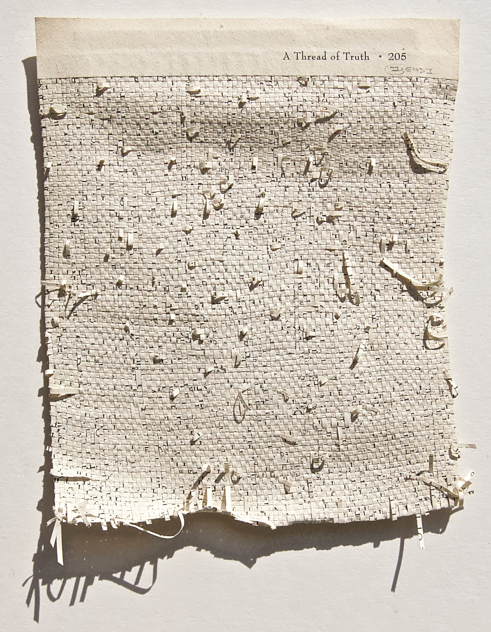 The Thread of Truth, hand-cut deacidified pages of reclaimed book | Youdhisthir Maharjan | STIRworld