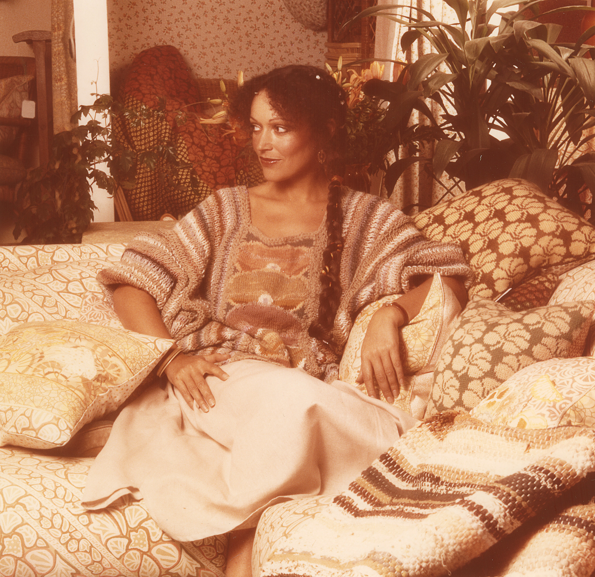 Surrounded by her Geranium Collection, 1976. Designed by Kaffe Fasett for Designers Guild | Tricia Guild| STIRworld