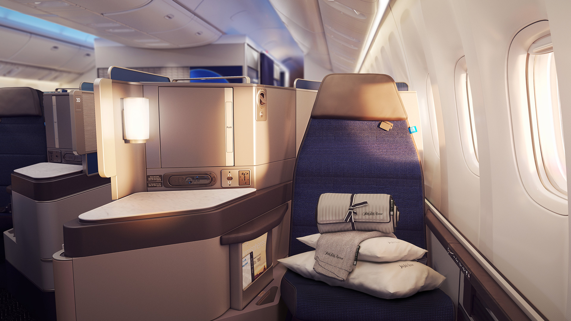 The United Polaris seat, designed by PriestmanGoode and United Airlines as part of Polaris cabin and lounge for United Airlines, offers passengers more lighting control and an additional signature reading light | Paul Priestman | PriestmanGoode | STIRworld