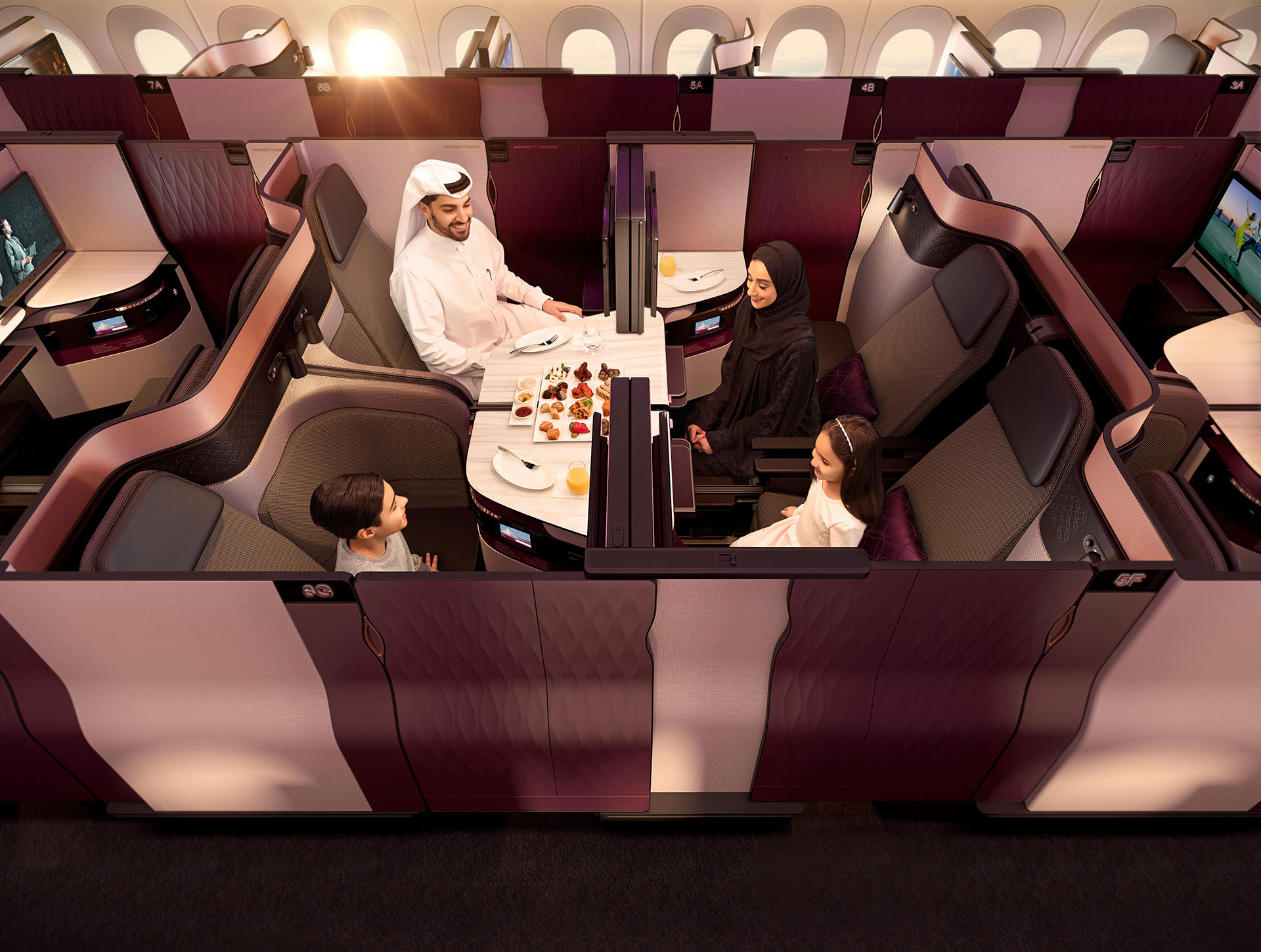 Qatar Airways' First Class Cabin designed by PriestmanGoode and Qatar Airways provides passengers tables large enough for work and dining | Paul Priestman | PriestmanGoode | STIRworld