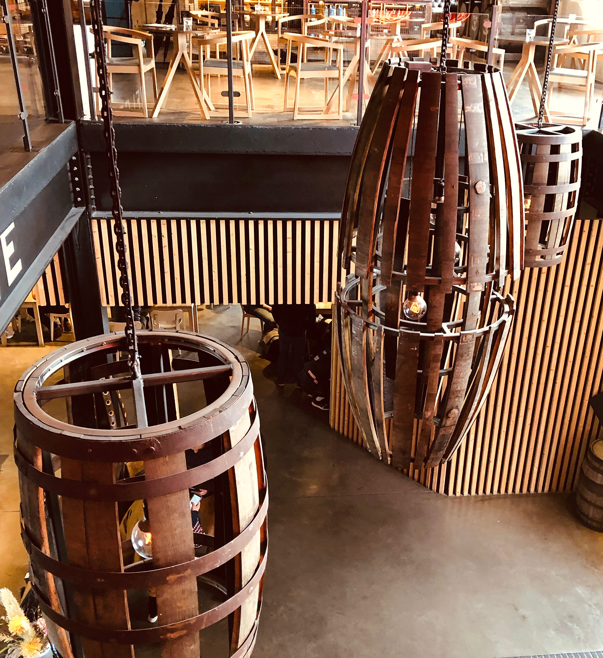 Old whiskey barrels fashioned as light fixtures at the Teeling Distillery | Dublin | STIRworld