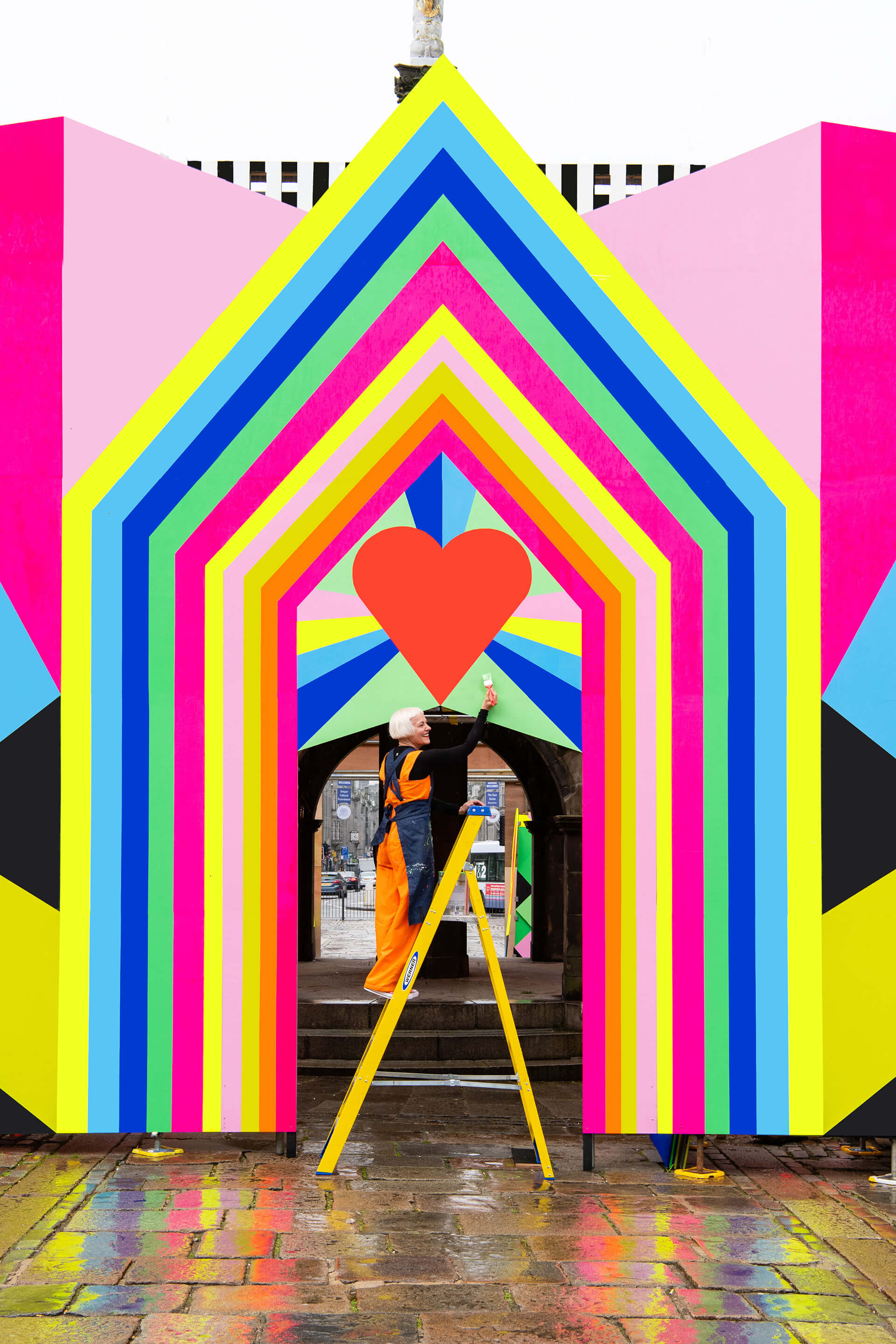 Myerscough painting at her installation Love at First Sight in Aberdeen, which she dedicated to her parents | Morag Myerscough | Women in Design 2020+ | STIRworld