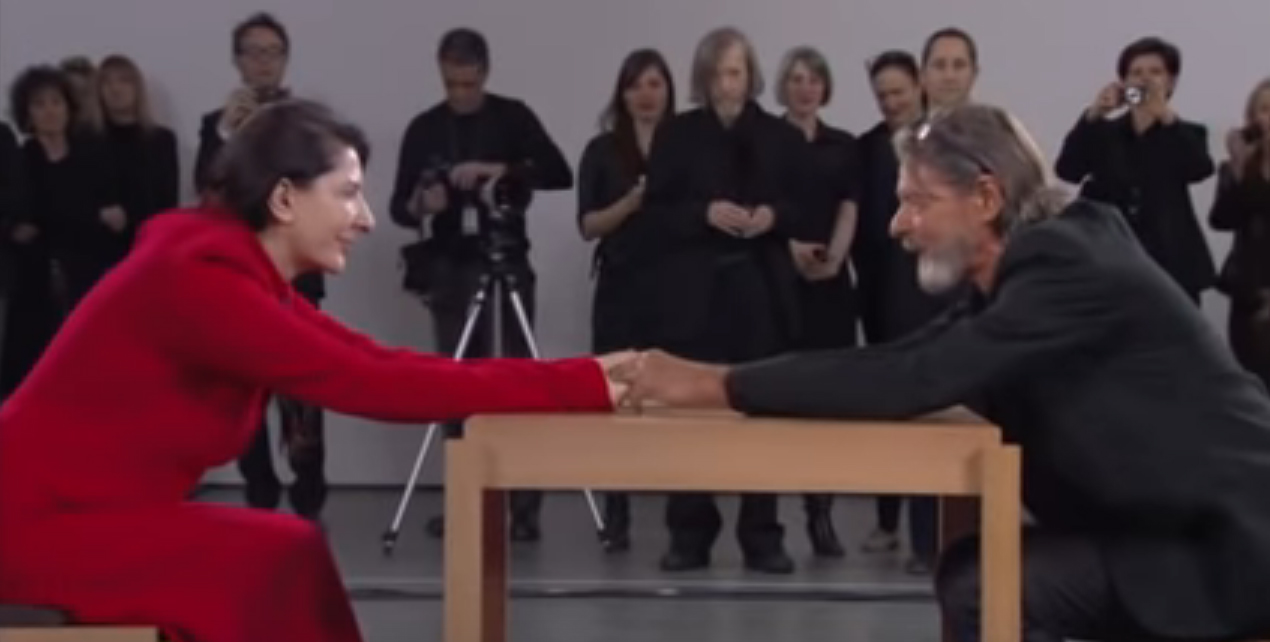 Ulay sits across Marina Abramović, during her performance titled The Artist is Present, at MoMA, New York, USA, 2010 | Tribute to Ulay | STIRworld