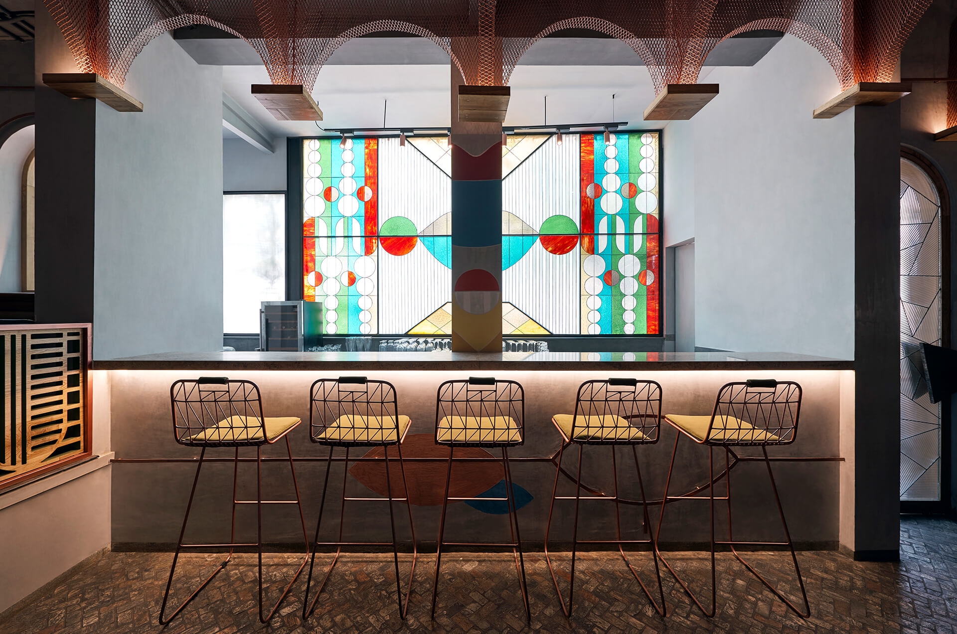 Stained glass window at the back of the bar  | Bengaluru, India | FADD Studio | STIRworld