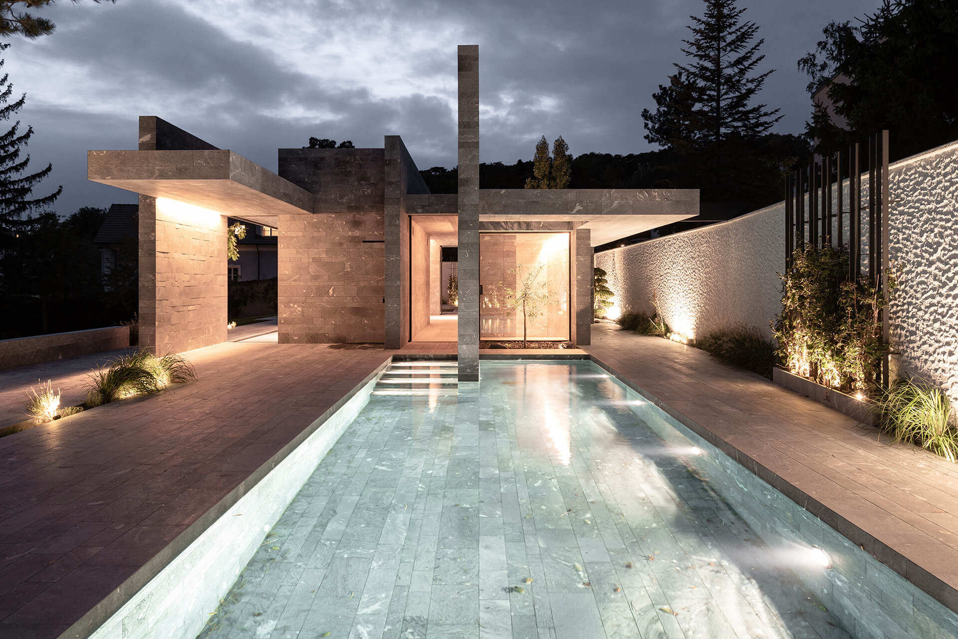 The stone slabs stand as monoliths designed to appear as free standing columns | Private Wellness Spa Pavilion  | Smartvoll Architects | STIRworld