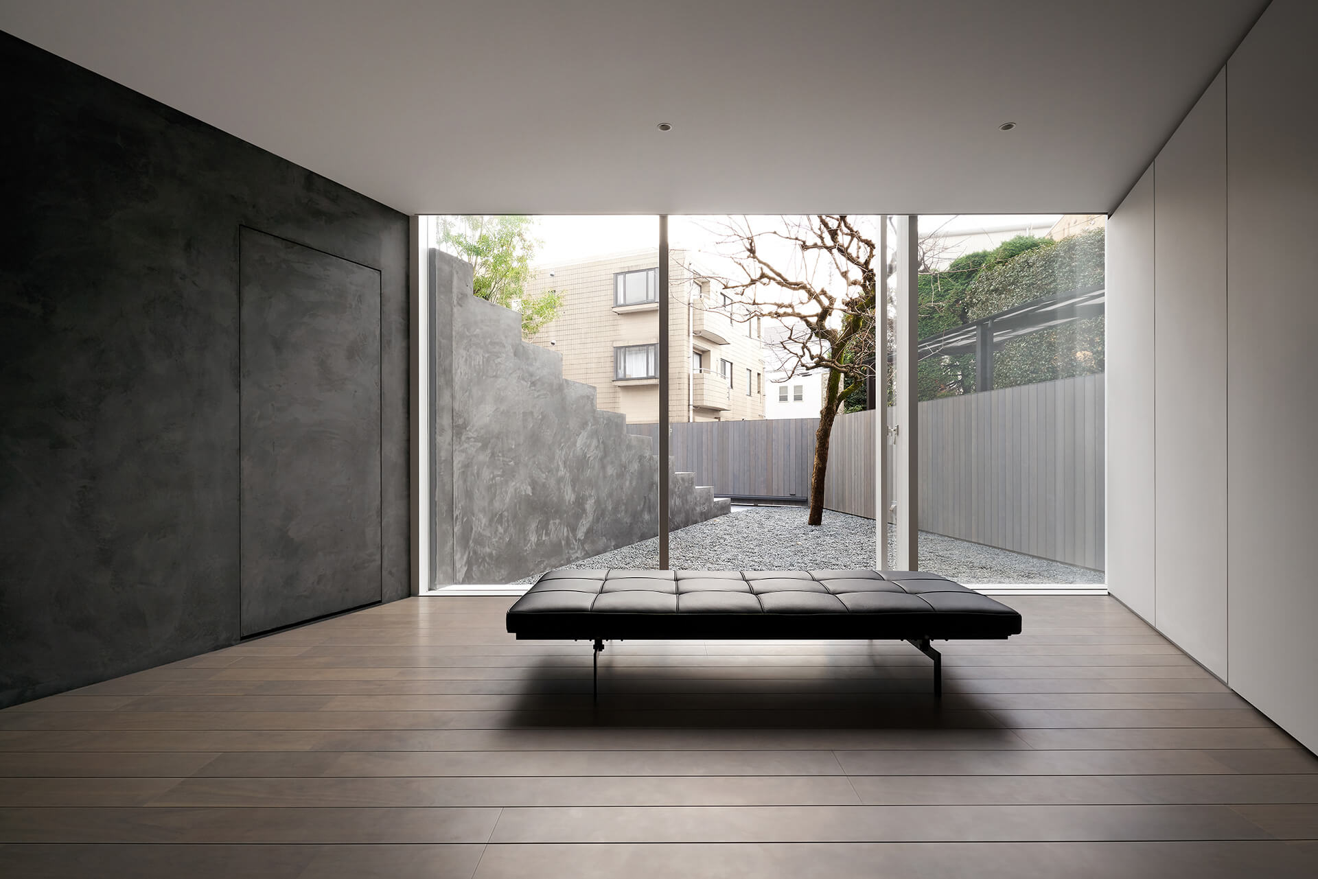 A solitary space on the ground floor overlooking the graveled yard | Tokyo | Nendo | STIRworld