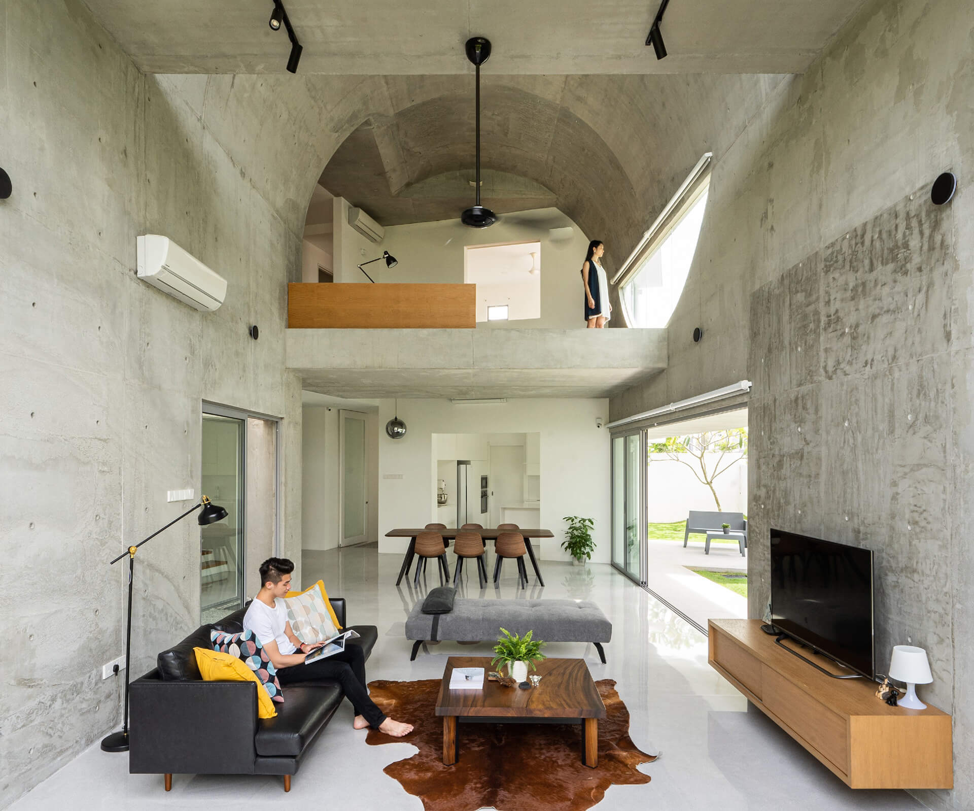 The living space with the dining and vaulted mezzanine in the background | Kuala Lampur, Malaysia | Fabian Tan | STIRworld