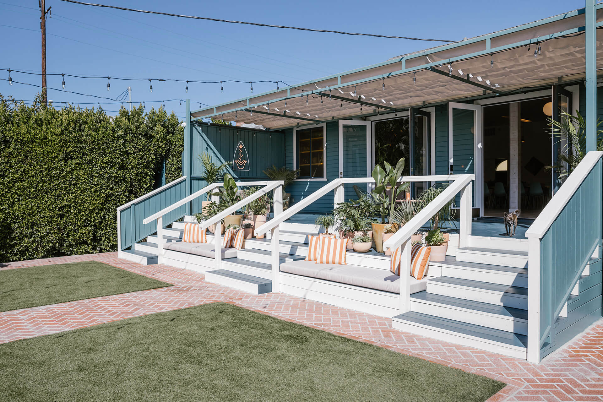 Accessed by wide steps, the large backyard will host film screenings, dinners and other communal events | The Ruby Street in LA is a coworking space by Working Holiday Studio and Francesca De La Fuente | STIRworld