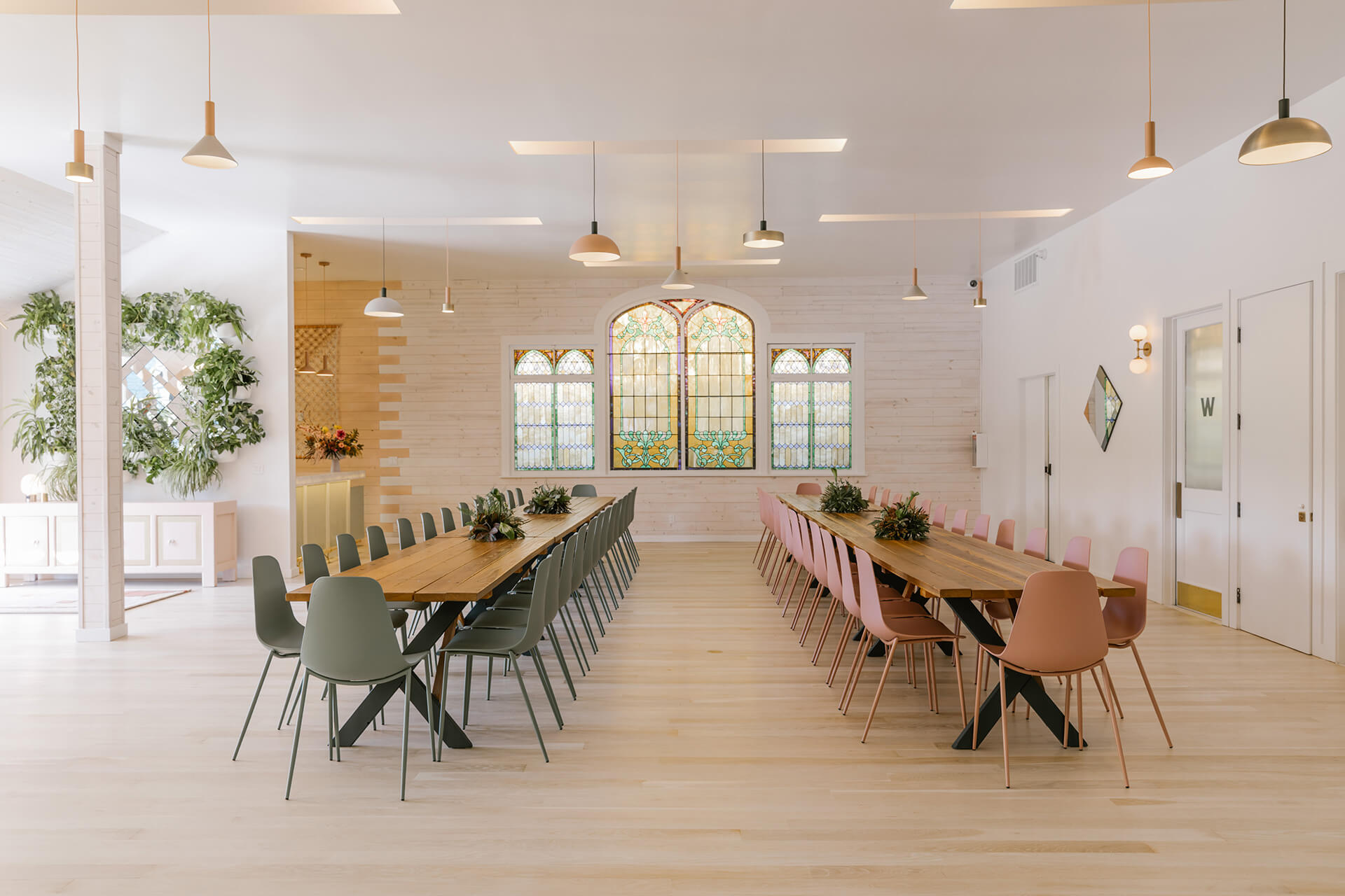 The Reception Hall sees long, wooden tables accompanied by chairs | The Ruby Street in LA is a coworking space by Working Holiday Studio and Francesca De La Fuente | STIRworld