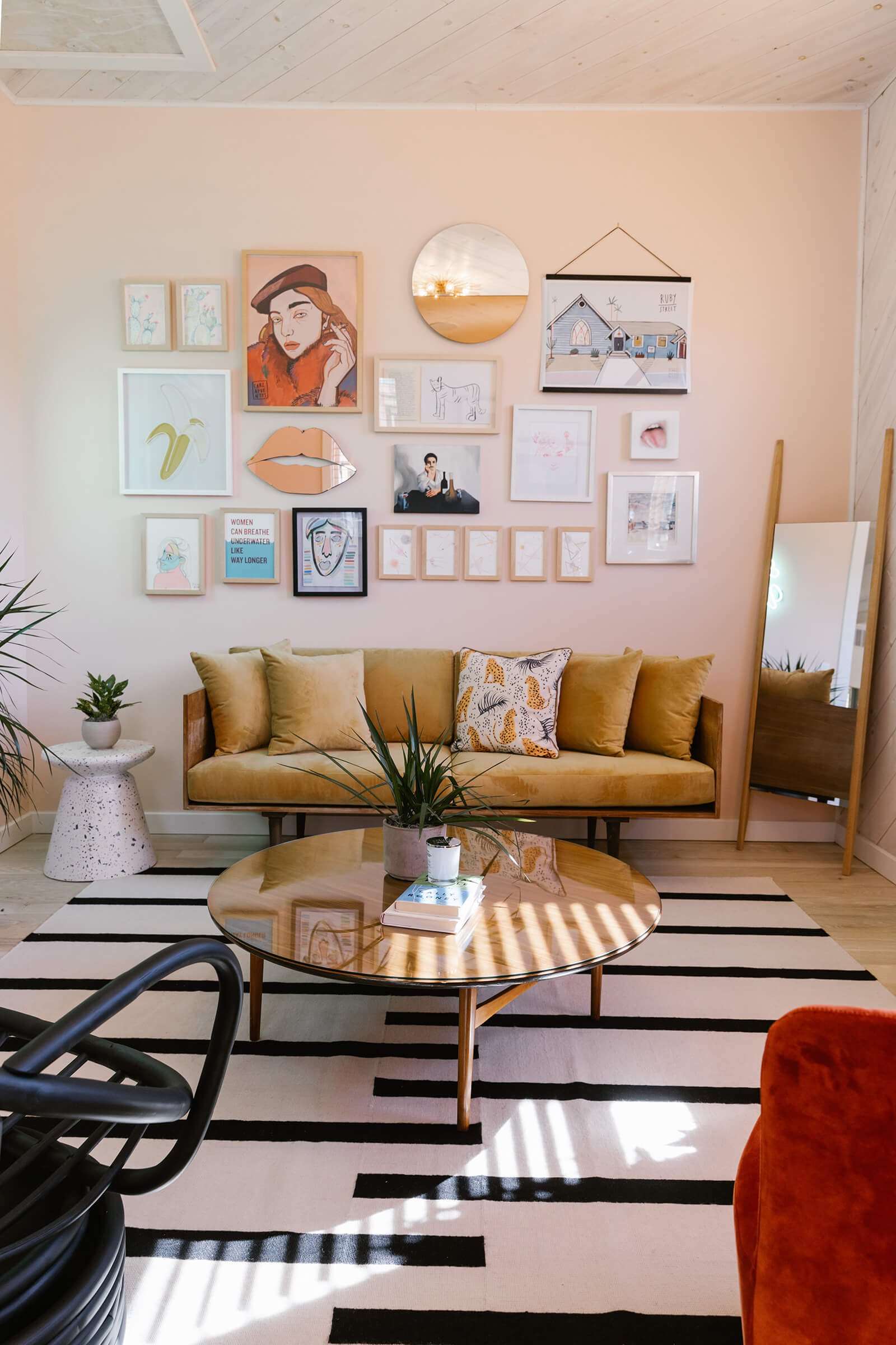 Furniture atop Danish rugs, overlooked by art on the wall | The Ruby Street in LA is a coworking space by Working Holiday Studio and Francesca De La Fuente | STIRworld