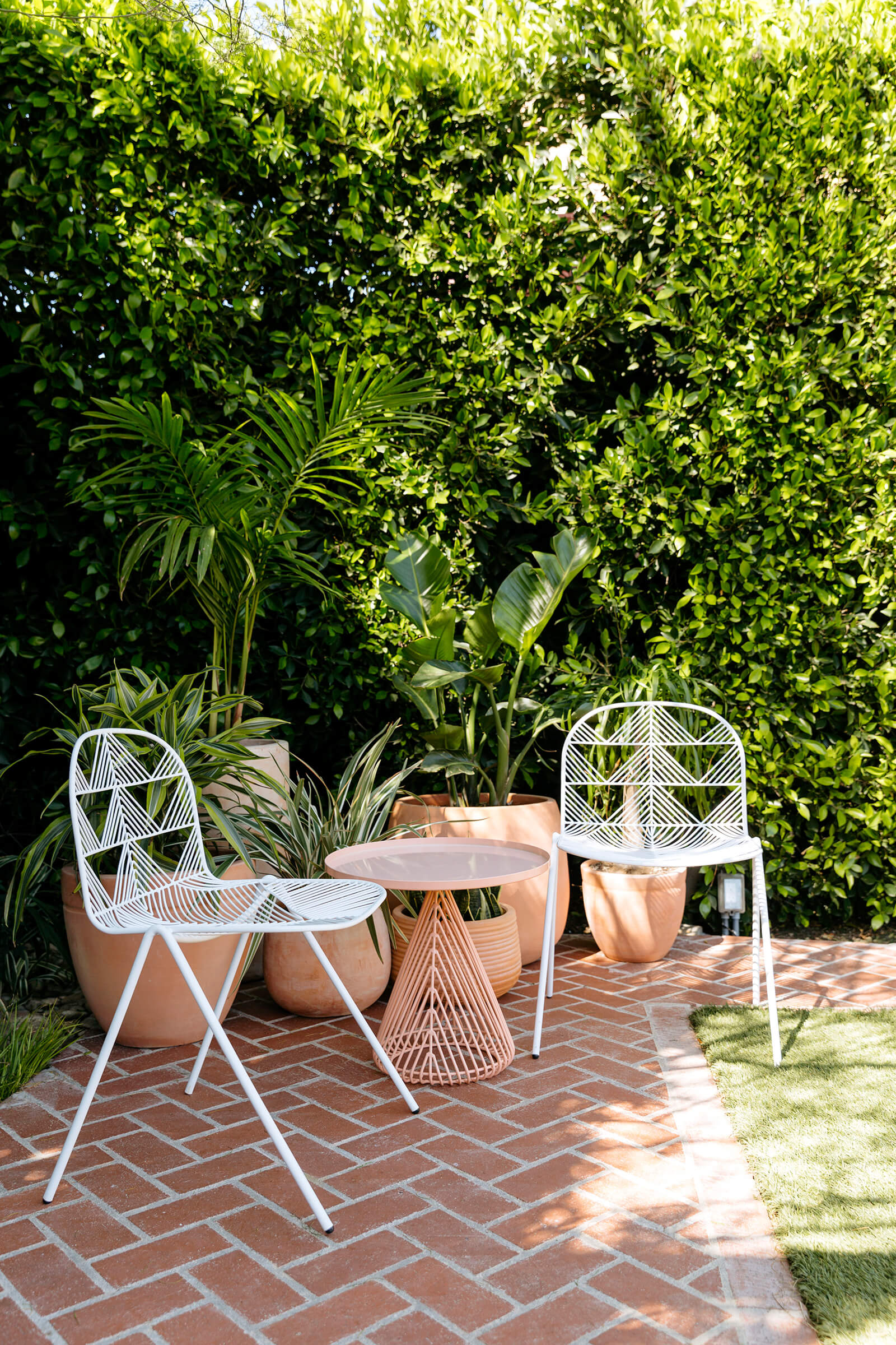 The Ruby Street's eye-catching outdoor furniture amidst the greens | The Ruby Street in LA is a coworking space by Working Holiday Studio and Francesca De La Fuente | STIRworld