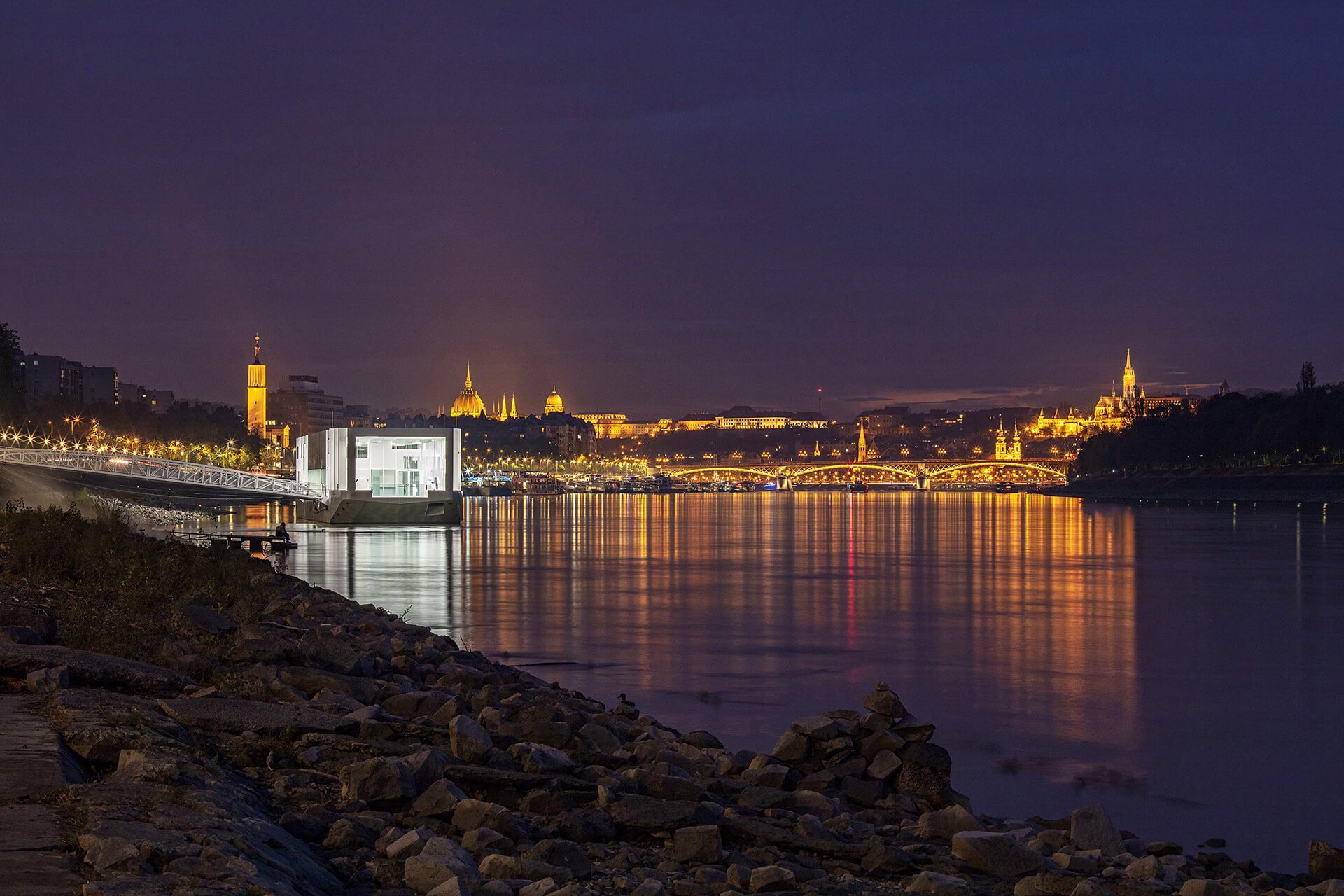 The Ark in the night light with the city of Budapest in the background | The Ark | Napur Architecture | STIRworld