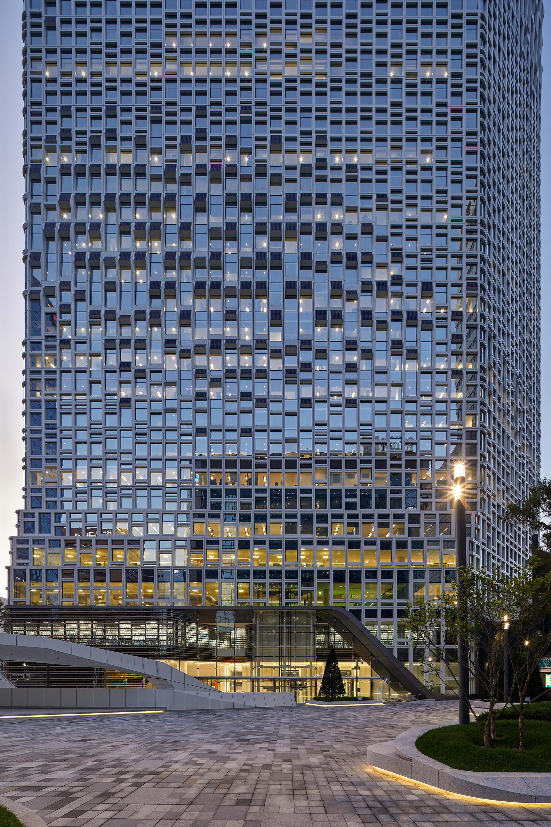The tower's facade is fitted with a myriad of shiny solar panels, which hold countless photovoltaic cells | Hanwha Headquarters Remodelling by UNStudio | STIRworld