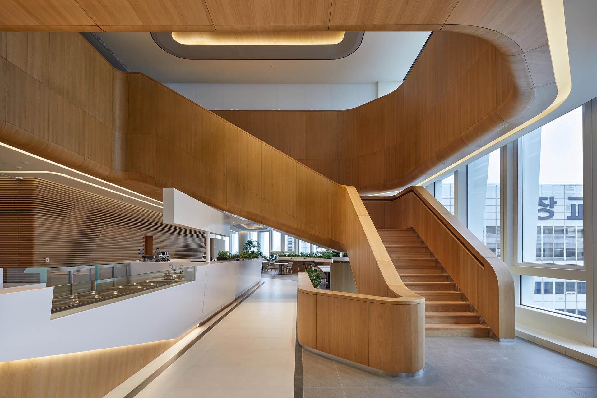 The interiors exhibit a calm colour scheme with subtle wood furnishing | Hanwha Headquarters Remodelling by UNStudio | STIRworld