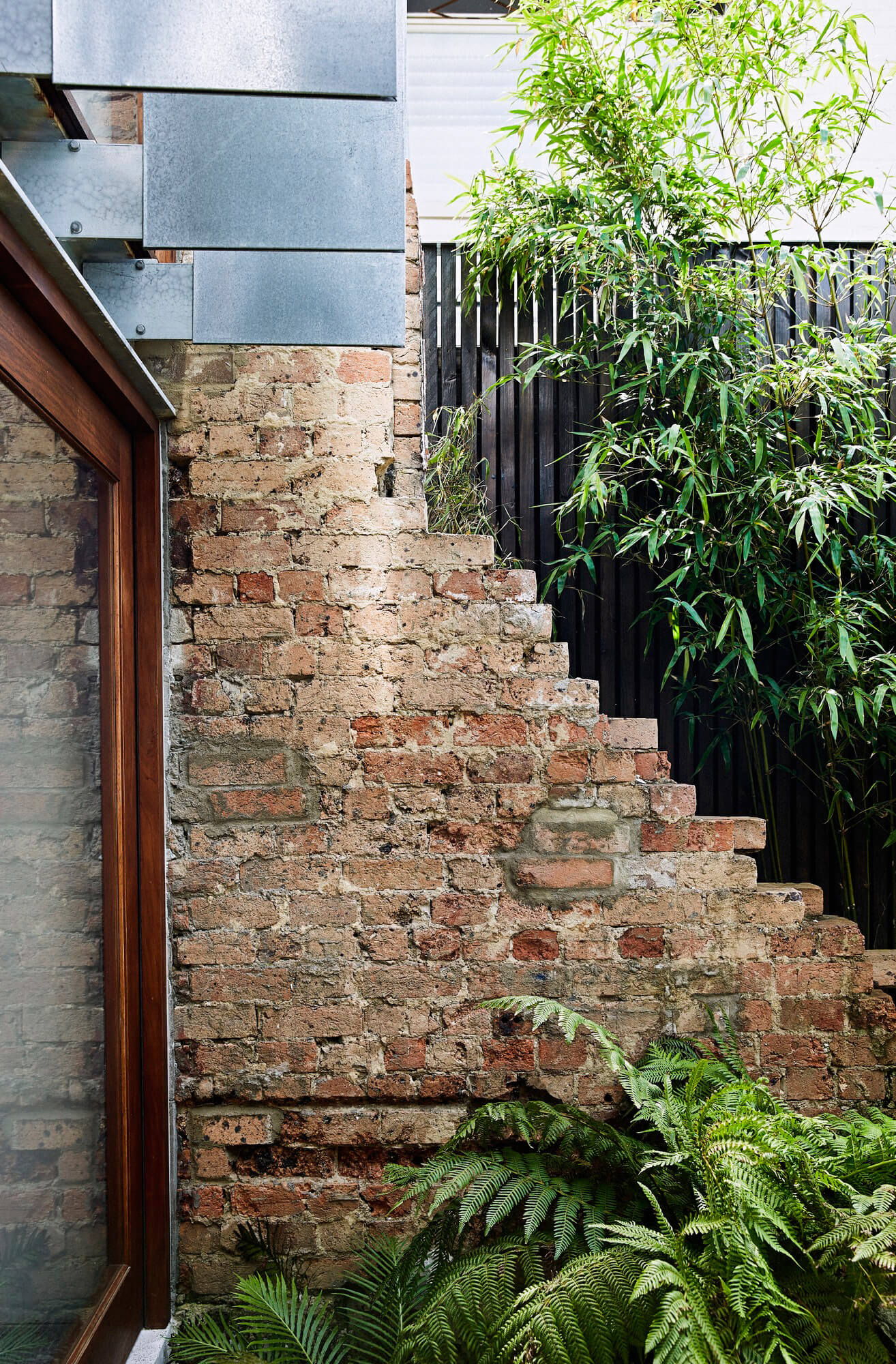 Elements of the old boarding house restored | Courtyard House by COX Architecture | STIRworld