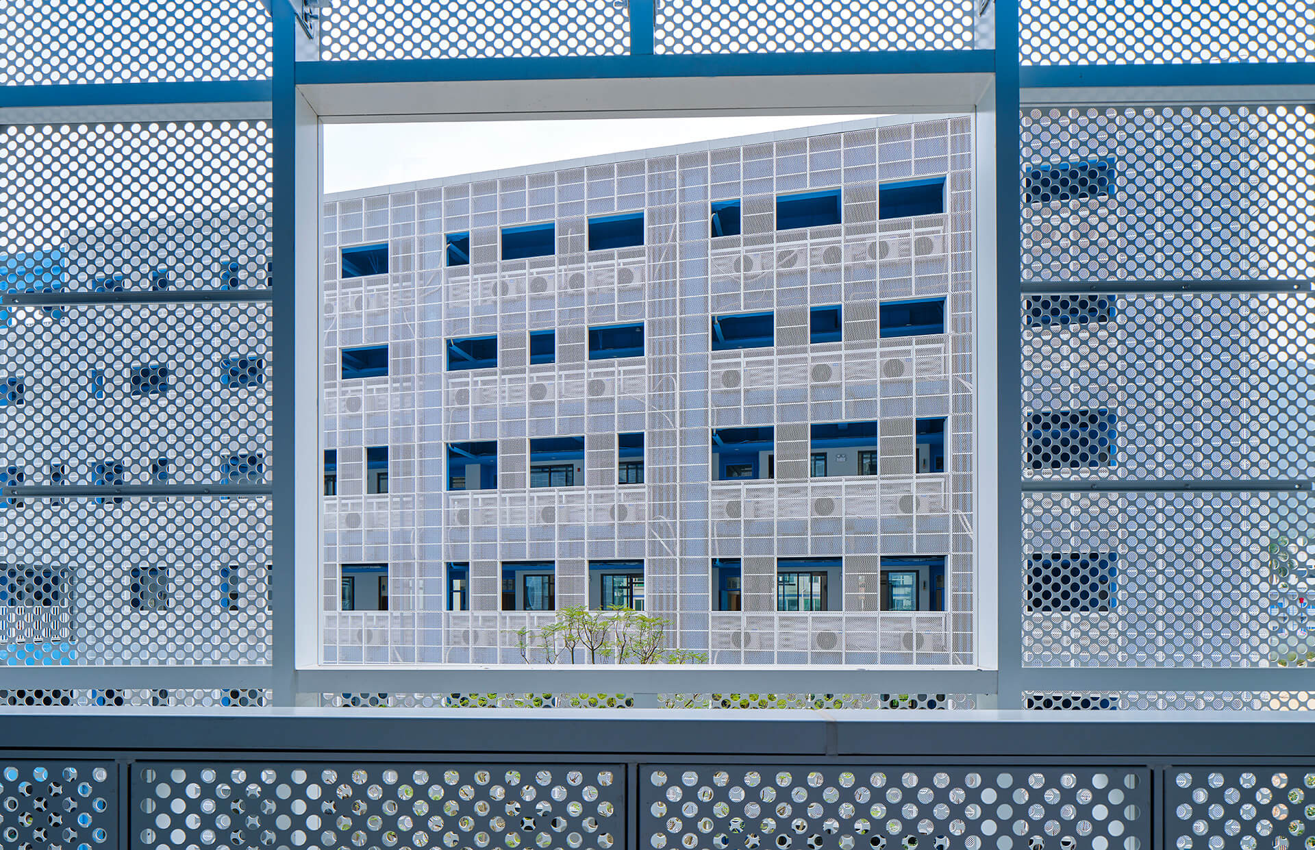 Perforated metal panels compose the facade | Crossboundaries | Shenzhen, China | STIRworld