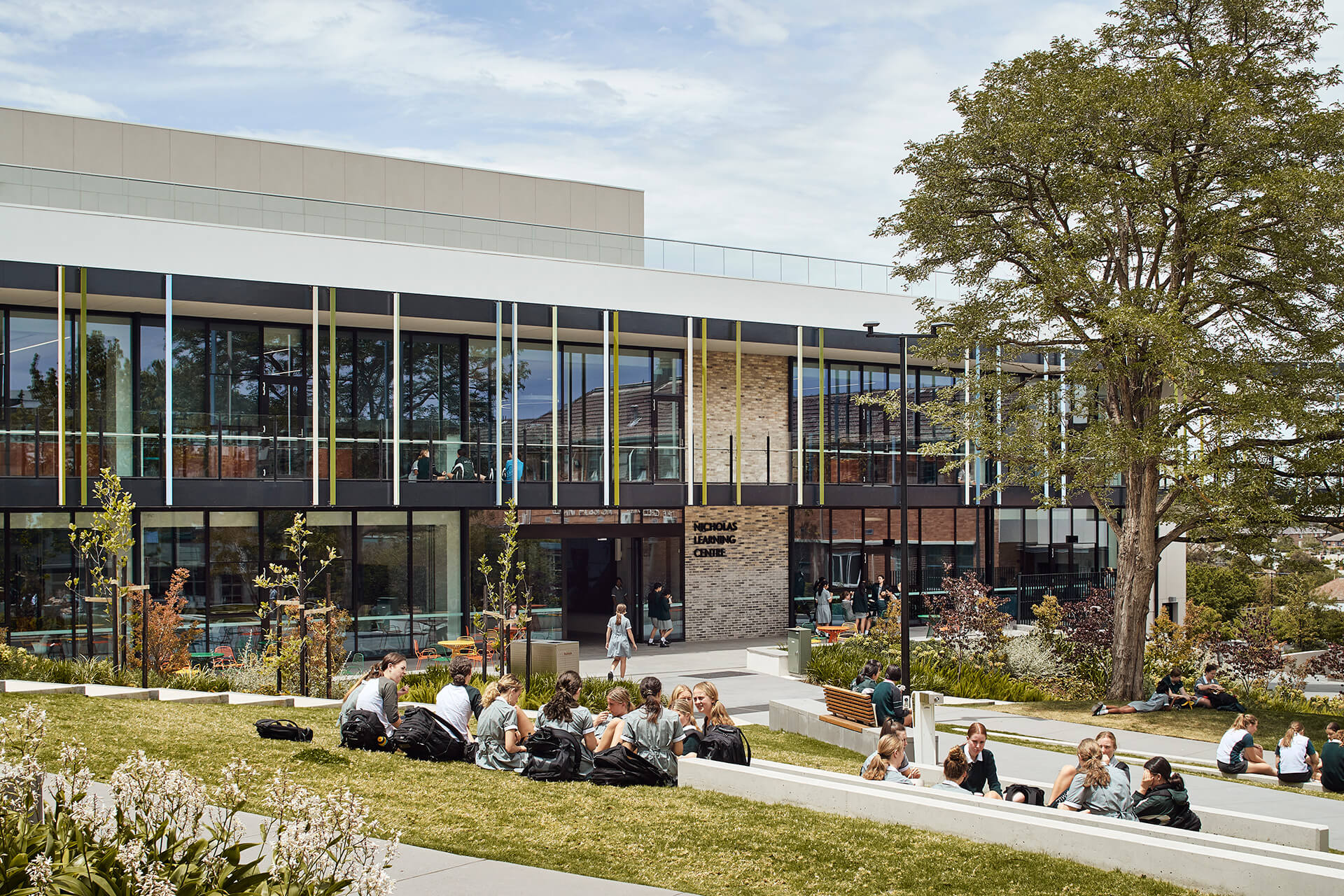 The perforated exterior of the building connects with the outdoors | MLC Nicholas Learning Centre by Mcildowie Partners| STIRworld