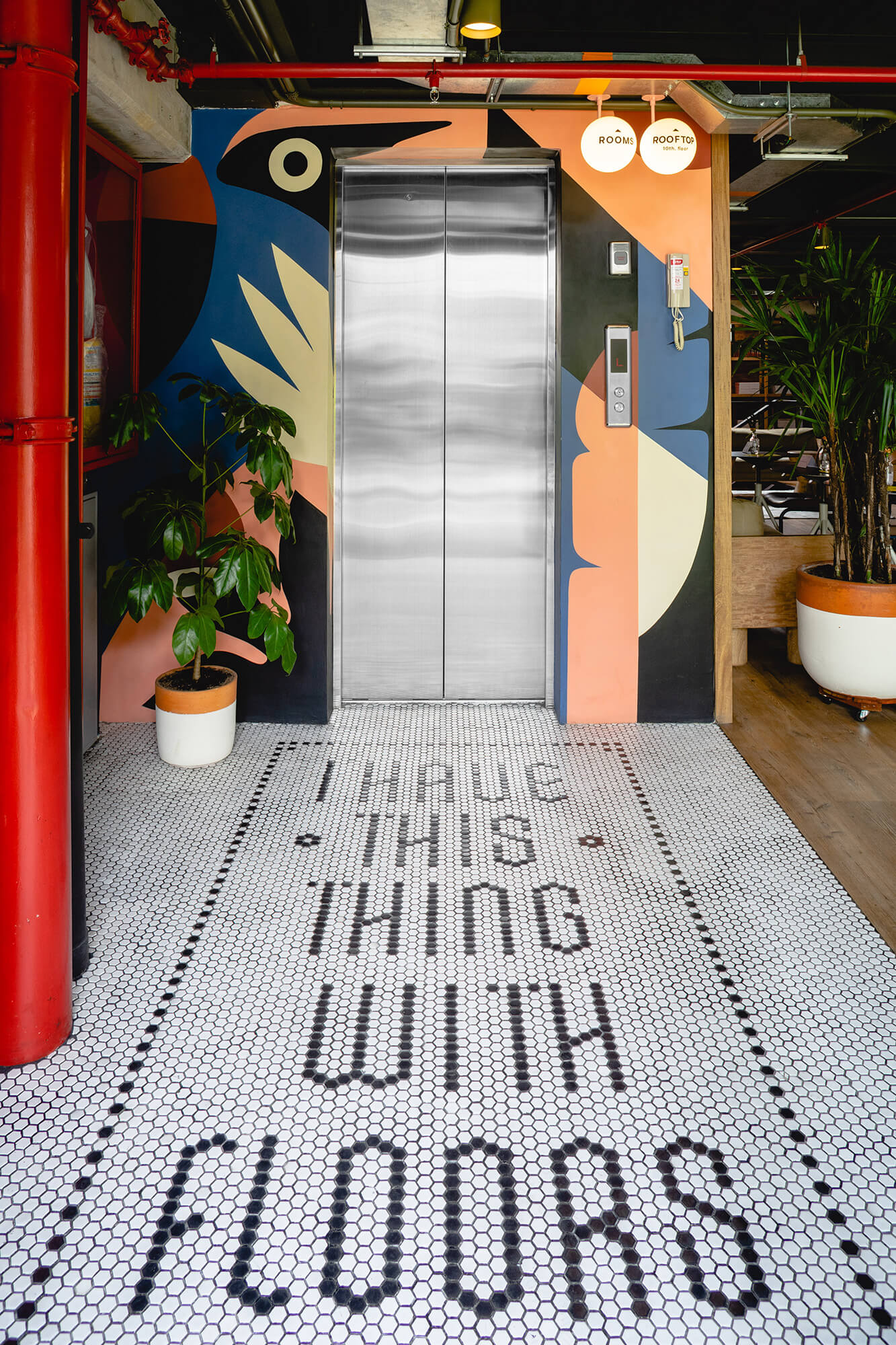 Mosaic flooring and murals around the elevator | A5 Arquitectura |  Medellí, Colombia | STIRworld
