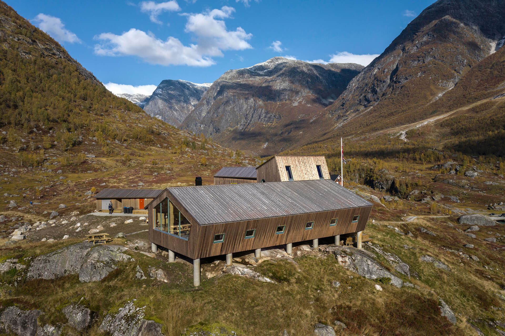 The main Tungestølen cabin with a sloped roof and timber work | Tungestølen Hiking Cabin by Snøhetta | STIRworld