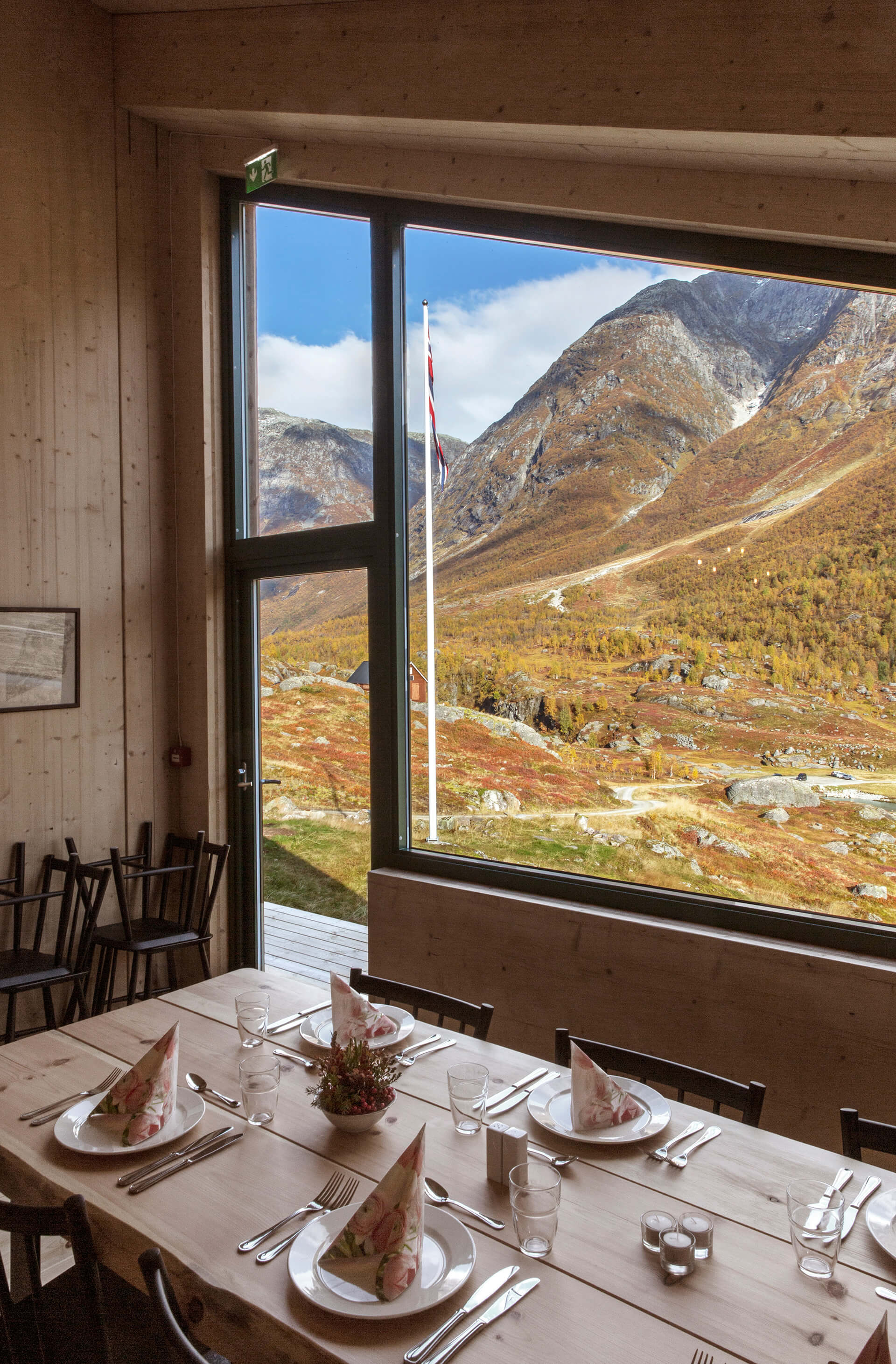 The dining room with views of the picturesque valley outside | Tungestølen Hiking Cabin by Snøhetta | STIRworld