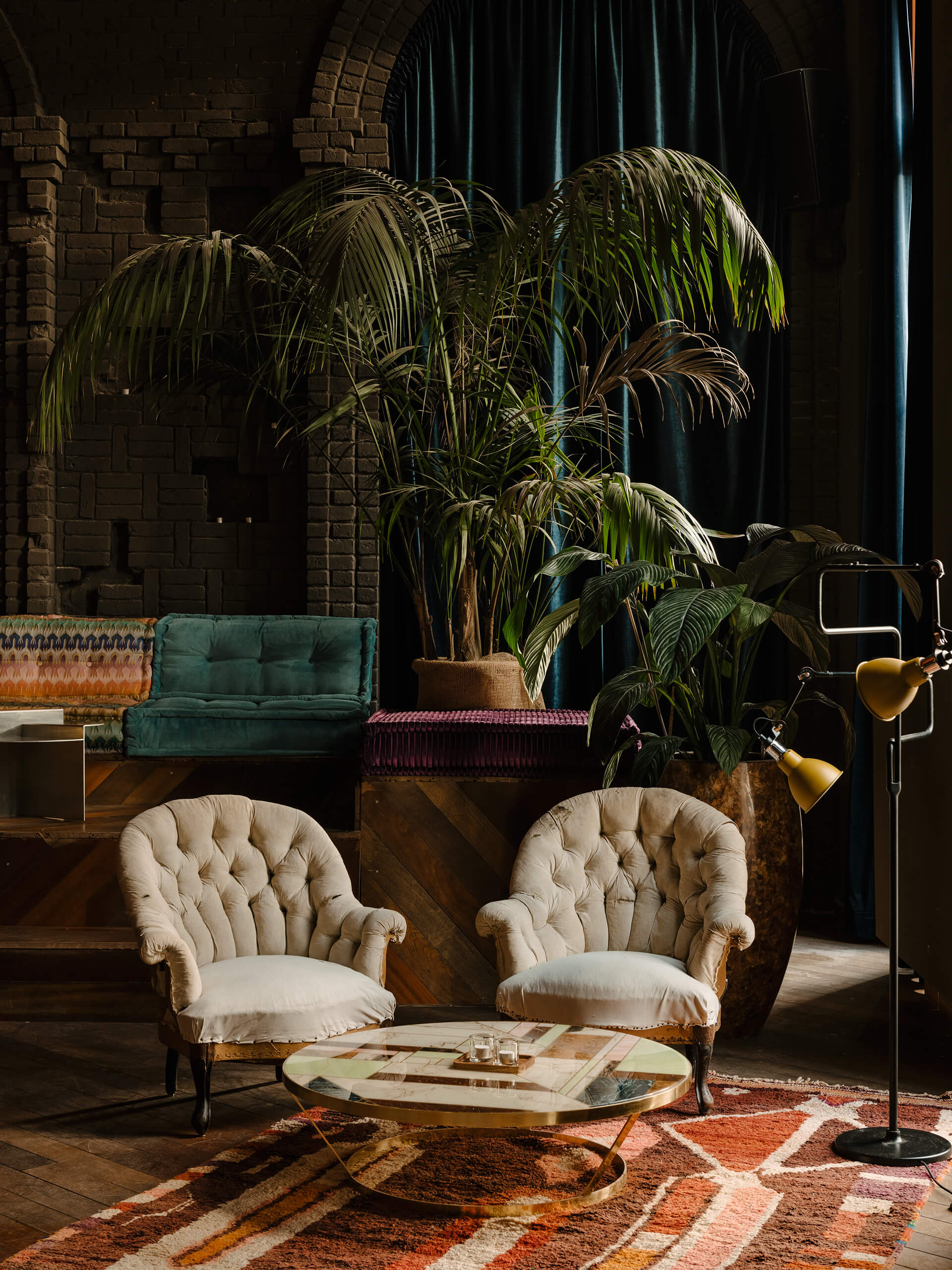 Furniture and plants add colour to the dusky interiors | KINK Bar and Restaurant by Oliver Mansaray and Daniel Scheppan | STIRworld