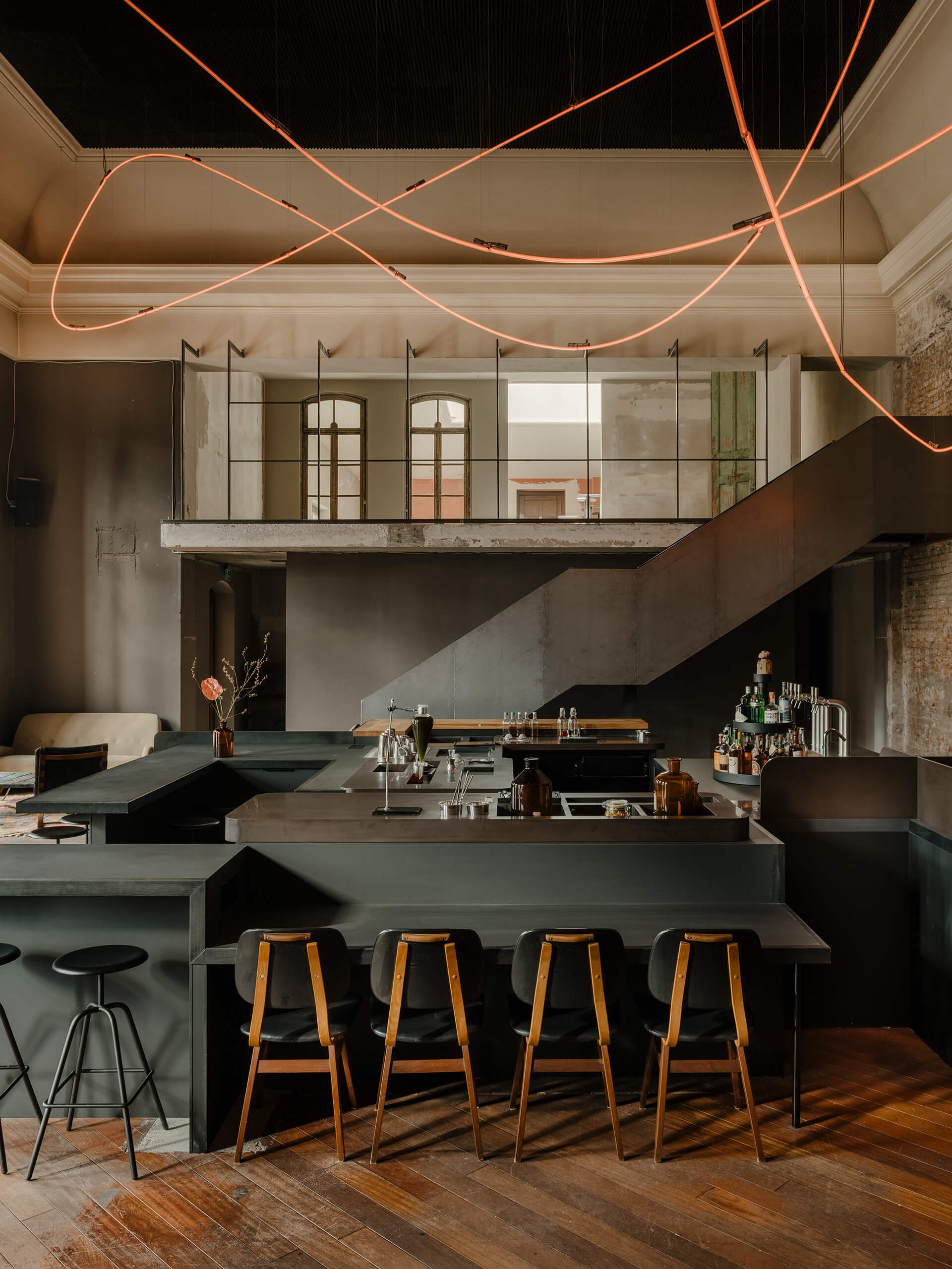 The bar below and galleries on the mezzanine | KINK Bar and Restaurant by Oliver Mansaray and Daniel Scheppan | STIRworld
