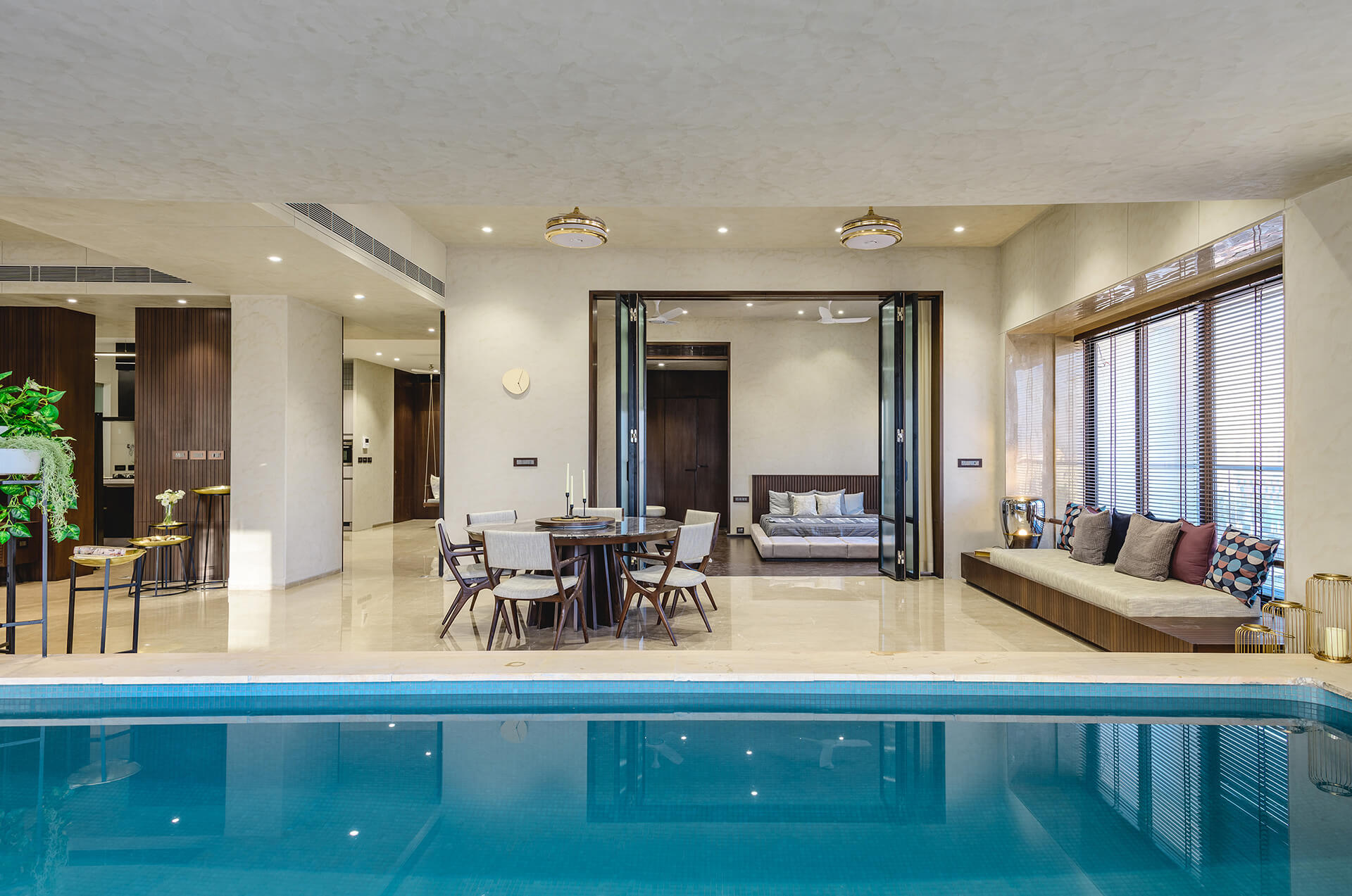 View of the dining area from the pool | Neogenesis + Studi0261 | India | STIRworld
