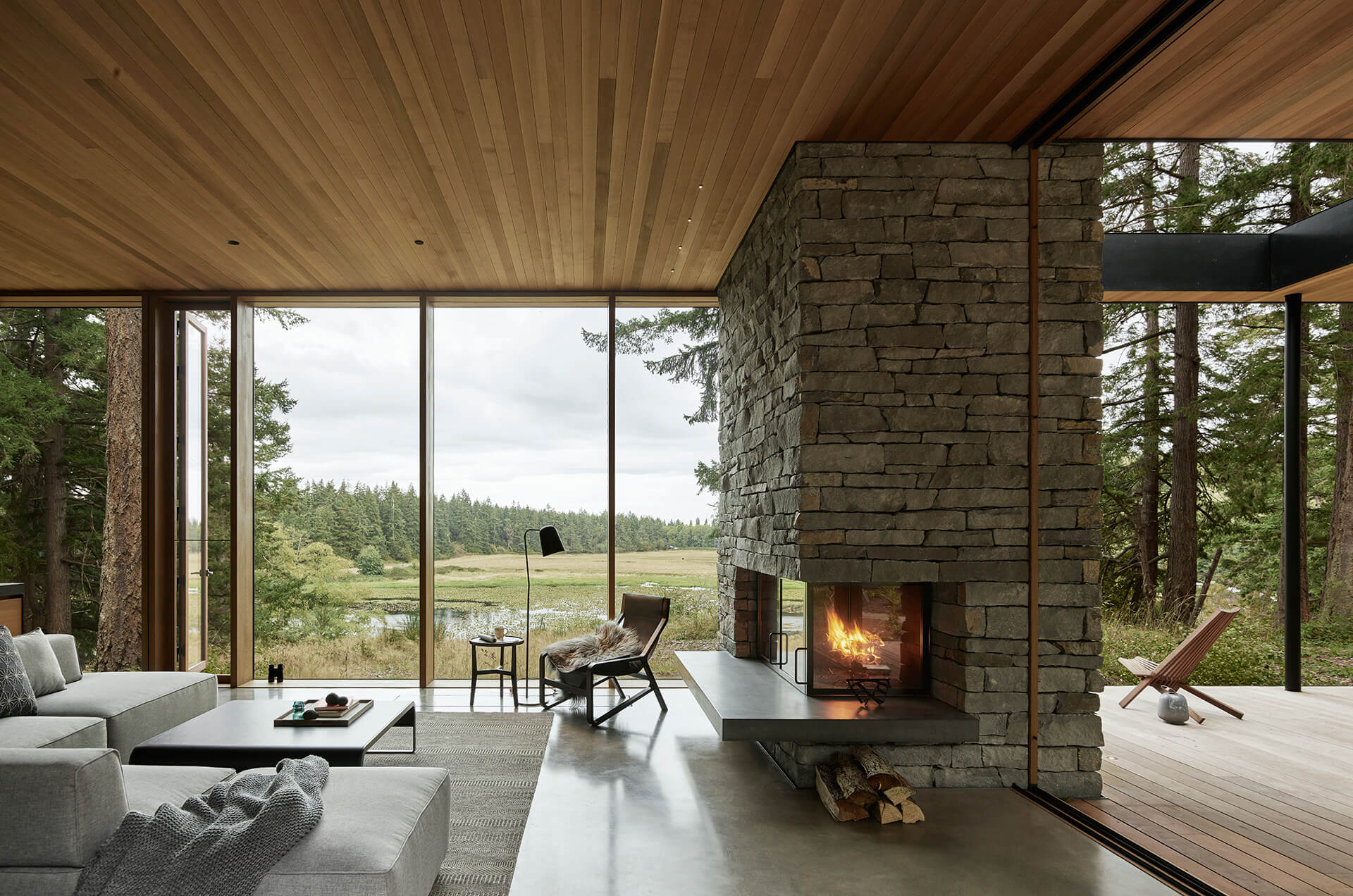Interior perspective framing views of the pastoral landscape | Whidbey Island Farm Retreat by mwworks | STIRworld