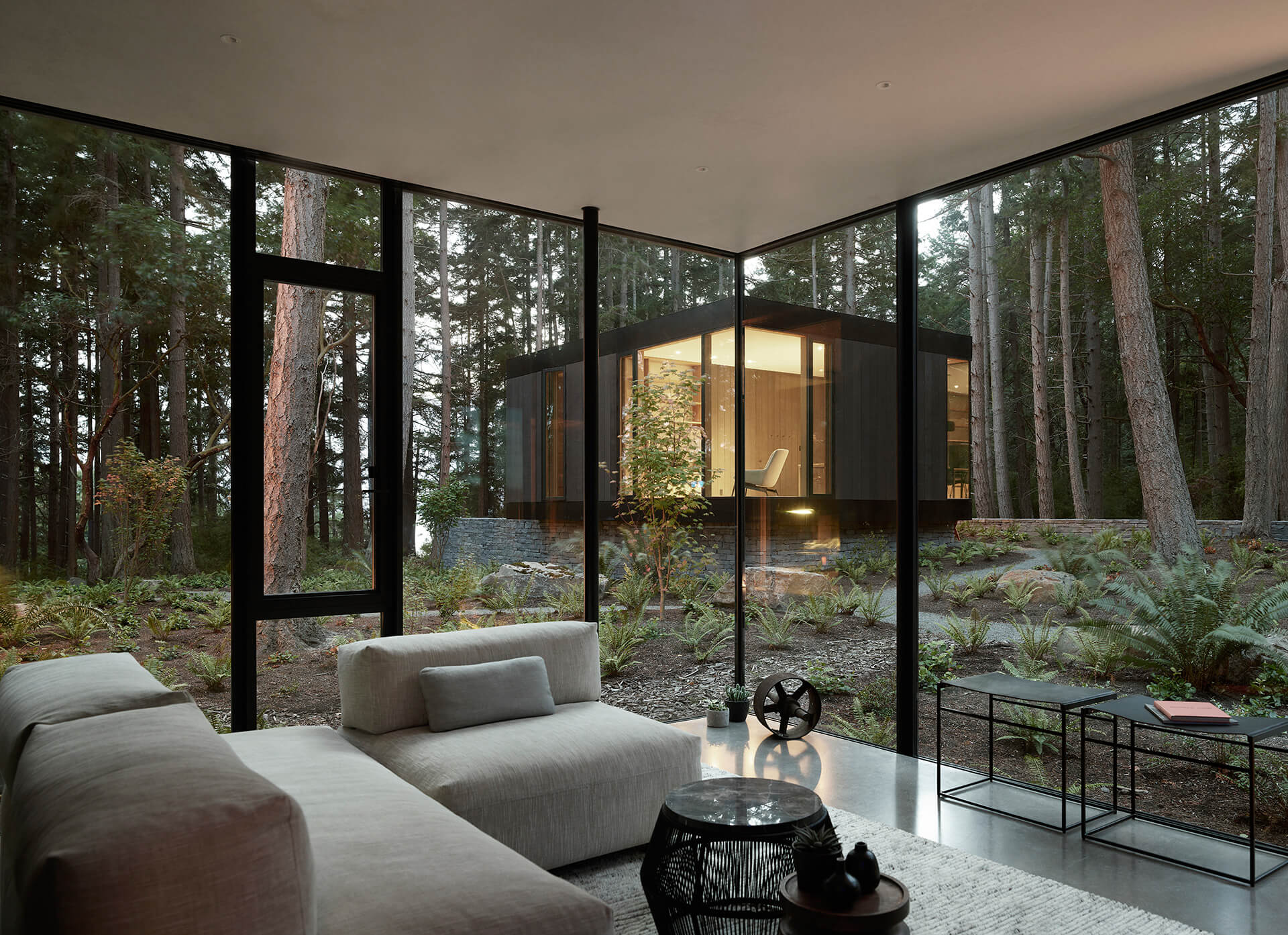 Tall glass volumes blending the Whidbey Island Farm Retreat into the landscape | Whidbey Island Farm Retreat by Mwworks | STIRworld