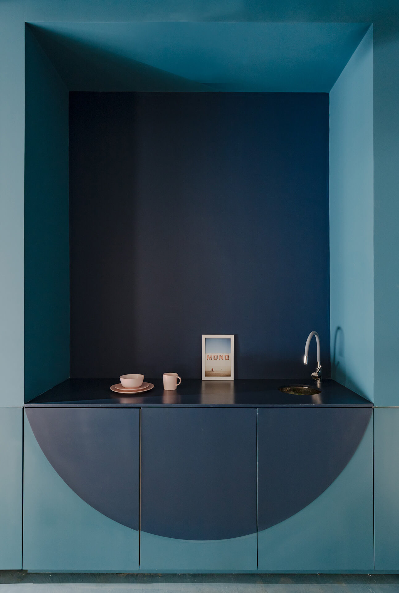 Cabinets and sink painted in two shades of blue | Fibras Orientadas interior office designed by Juan Alberto Andrade and María José Váscones | STIRworld