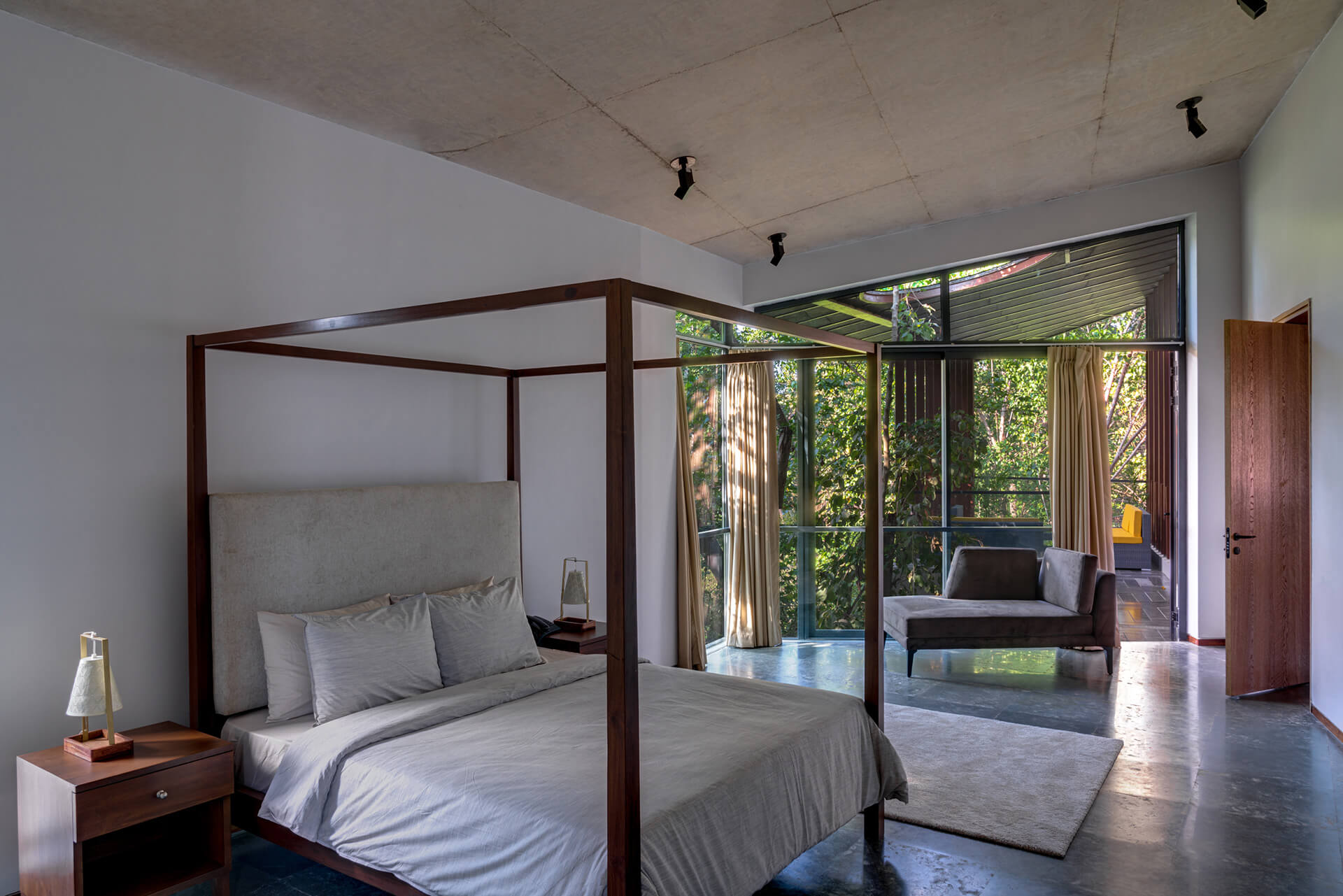 Terra's master bedroom highlighting its simplistic interiors and angular roof | Lua and Terra Si-oul villas by Kriss Real Estate and SAV architects | STIRworld