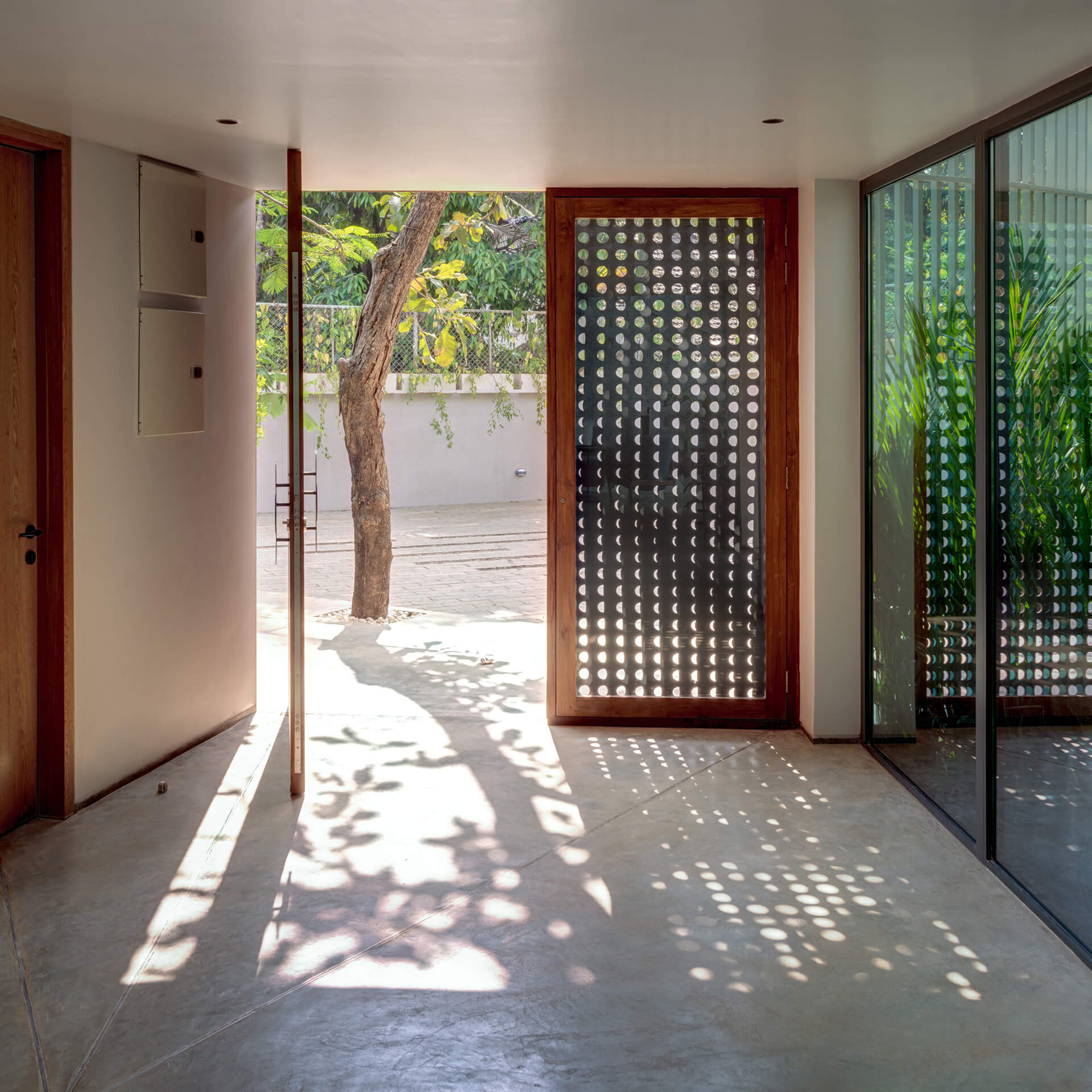Light filtering through moon motifs at Lua house's entrance door | Lua and Terra Si-oul villas by Kriss Real Estate and SAV architects | STIRworld