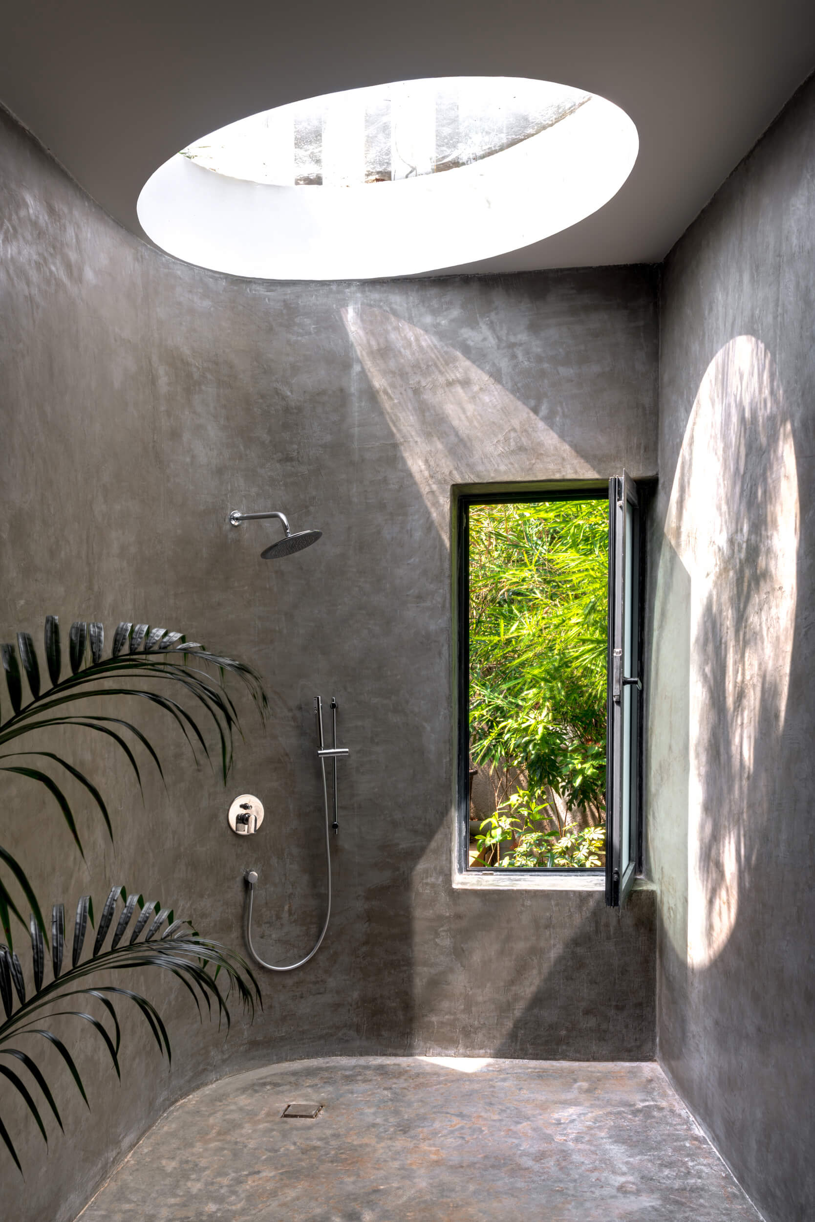 Grey toned minimalist style employed for Lua's bathroom in Lake Huron, Canada | Lua and Terra Si-oul villas by Kriss Real Estate and SAV architects | STIRworld