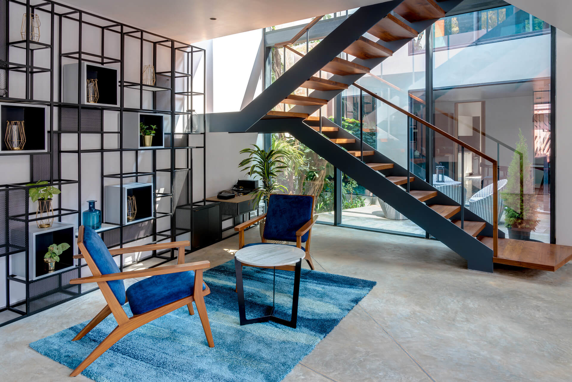 Contemporary interiors of moon house's living space | Lua and Terra Si-oul villas by Kriss Real Estate and SAV architects | STIRworld