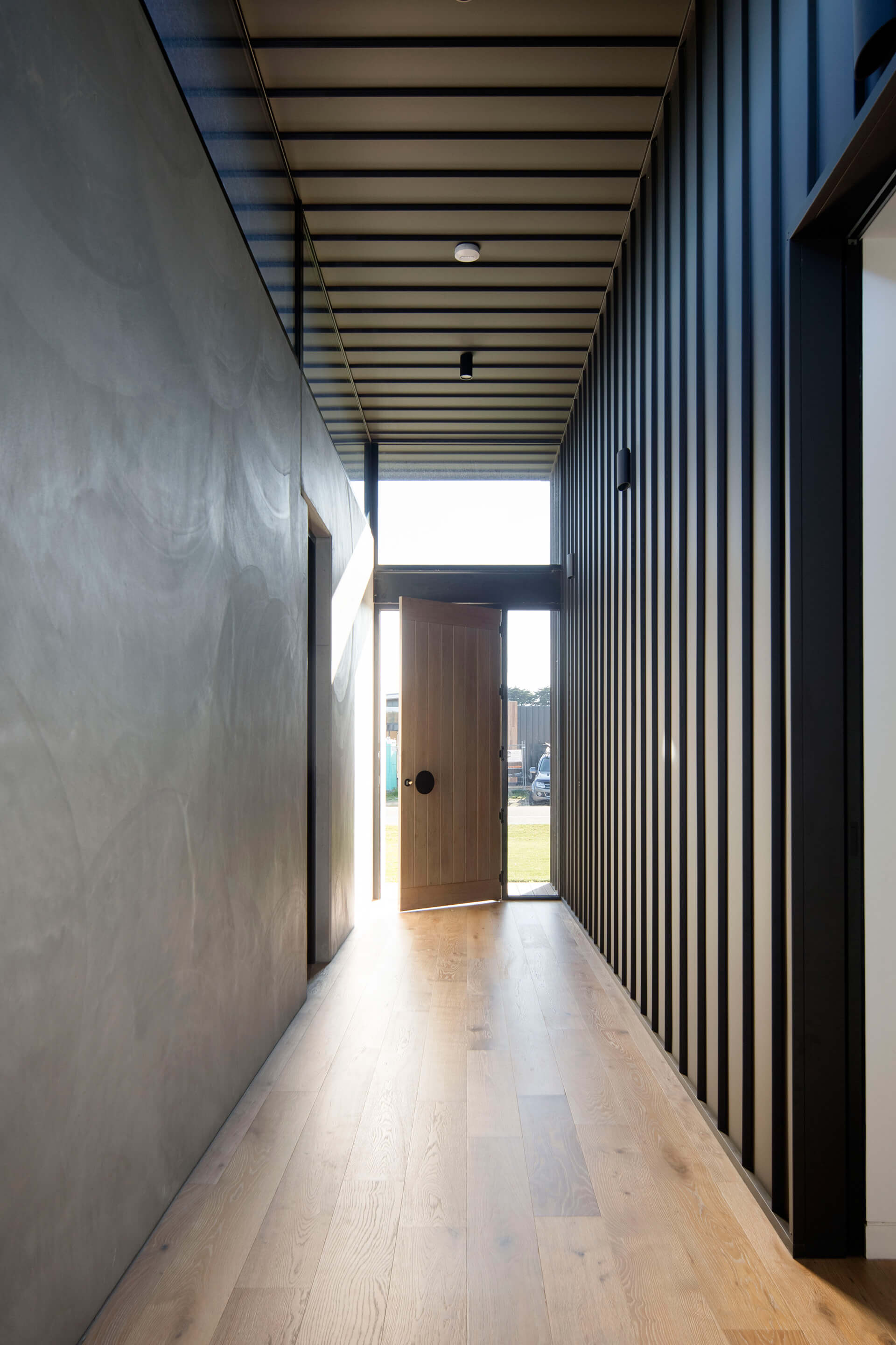 The entrance to the Cashmore House: structural steel and concrete used in its raw form | Cashmore House | Lachlan Shepherd Architects | STIRworld