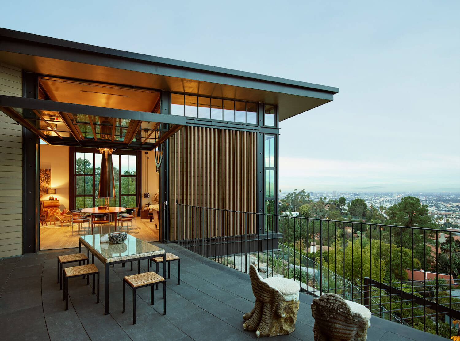 The terraces connect the indoors to the outdoors and capture views from the hilltop| Hollywood Hill House | Mutuus Studio | STIRworld